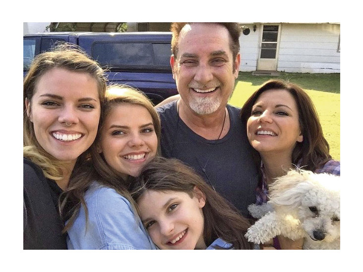 Martina McBride with husband John; daughters Delaney, Emma, and Ava; and dog Mae