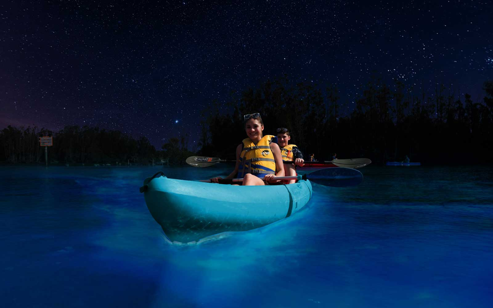 Night tours let you kayak over illuminated waters.