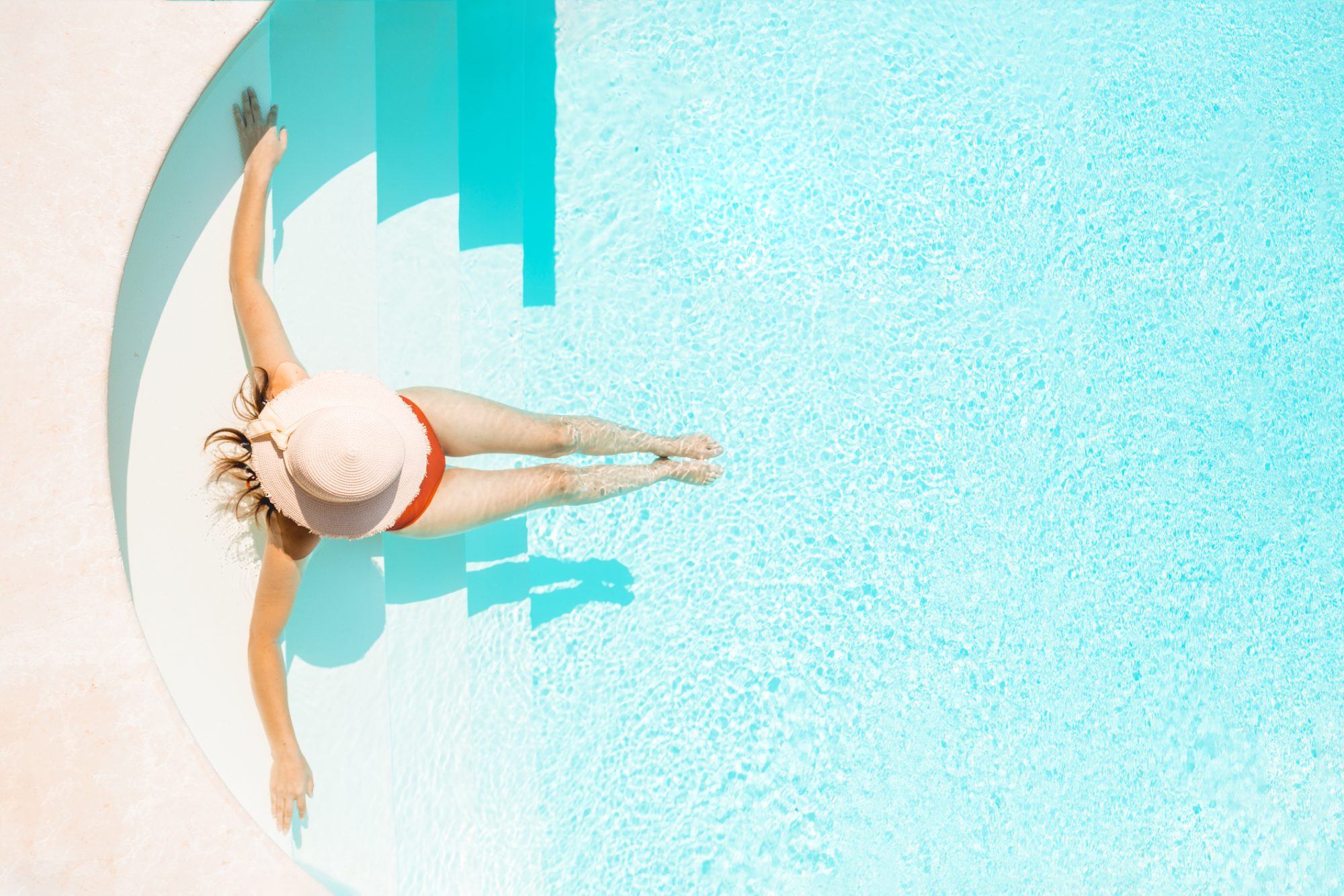 Woman Lounging in Pool