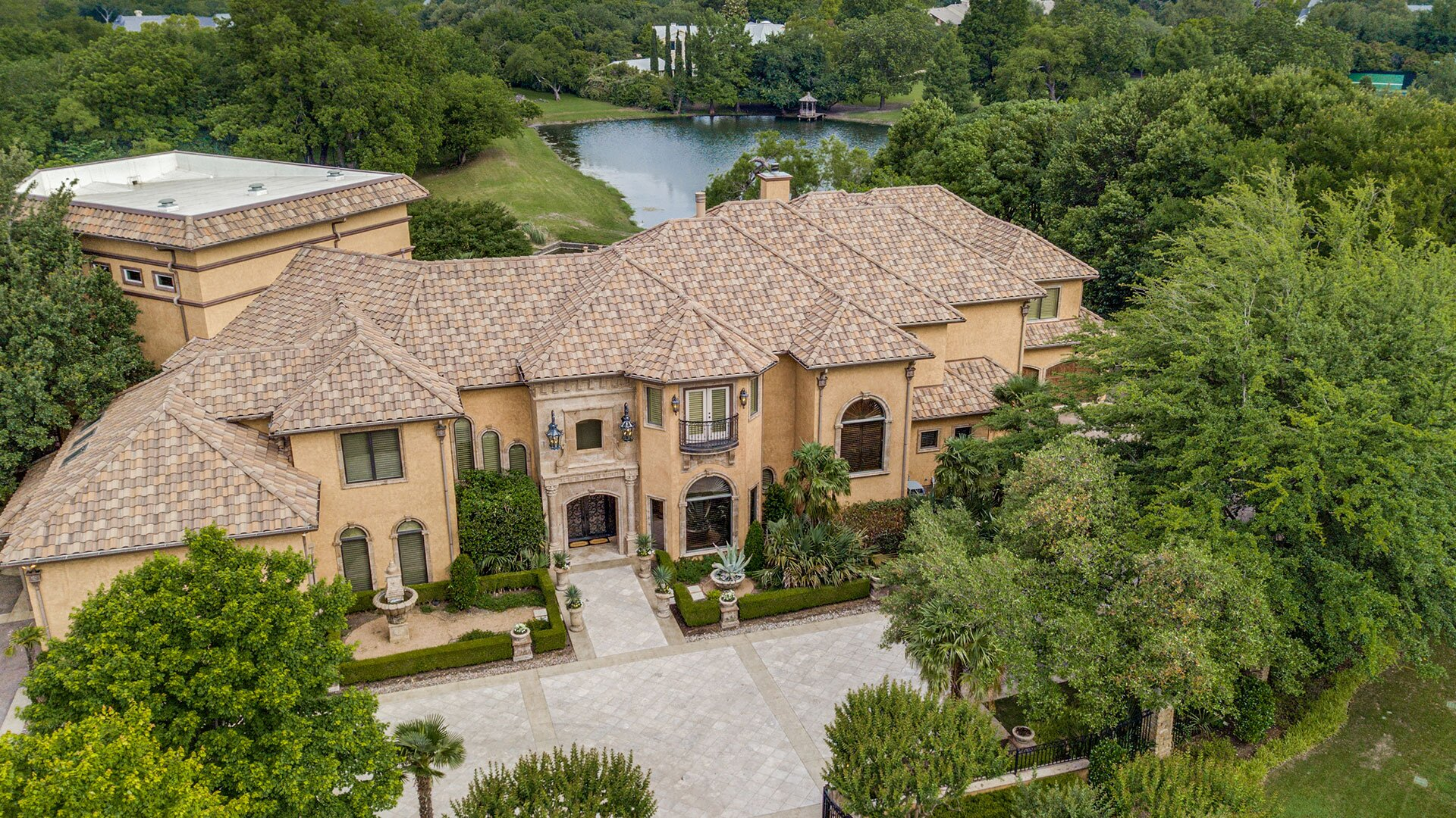 This Show-Stopping Texas Mansion Has a 90,000-Gallon Pool on nature house plans, dreams house plans, family house plans, bridge house plans, friends house plans, fishing house plans, life house plans, dogs house plans, yoga house plans, funny house plans, basketball house plans, the pearl house plans, painting house plans, love house plans, personal house plans, art house plans, water house plans,