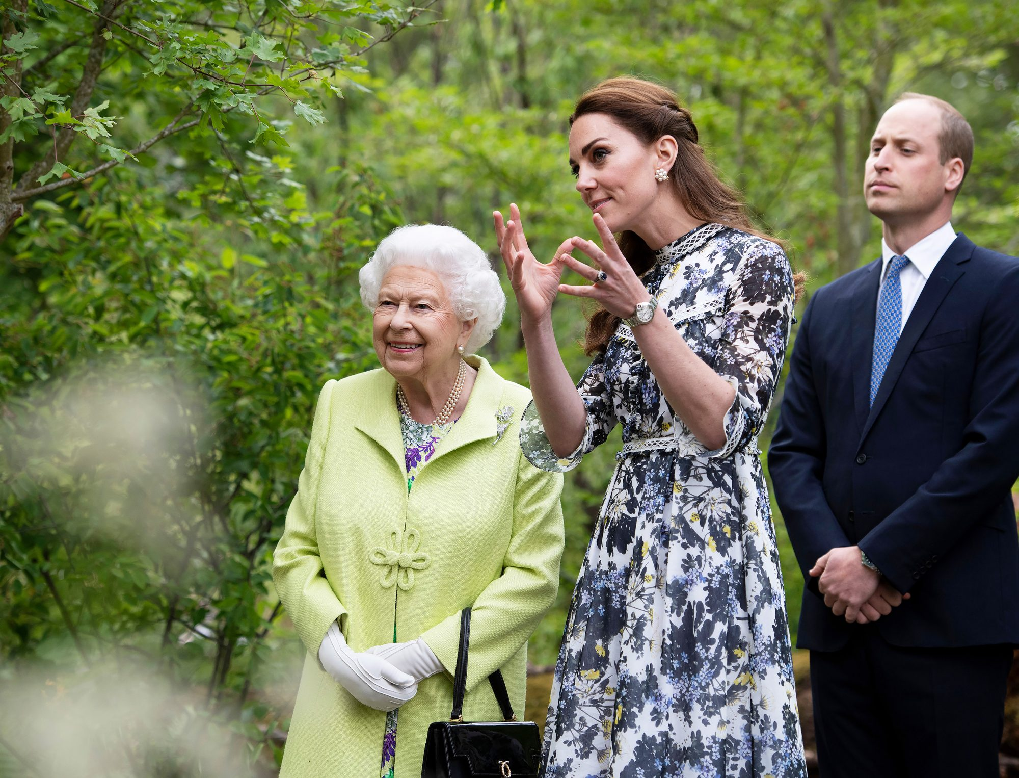 Queen Elizabeth II is shown around 'Back to Nature' by Prince William and Catherine Duchess of Cambridge