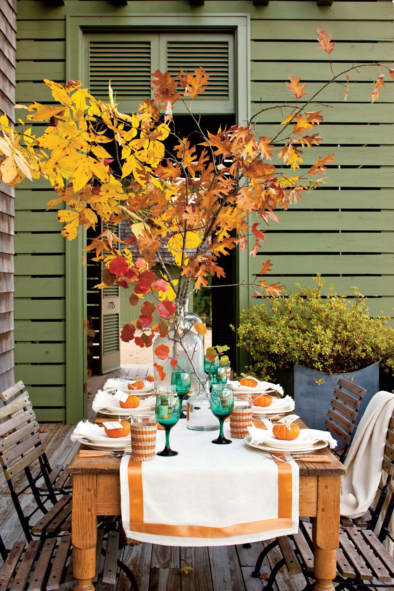 Fall Table Setting with Pumpkins and Fall Leaves by Lindsey Ellis Beatty