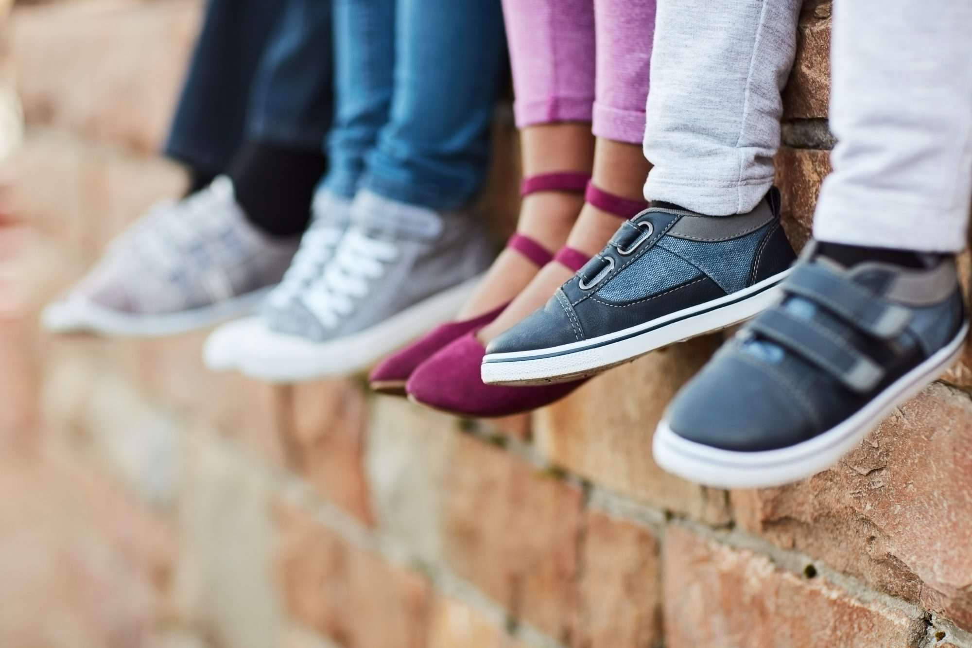 Kids with Shoes on Ledge