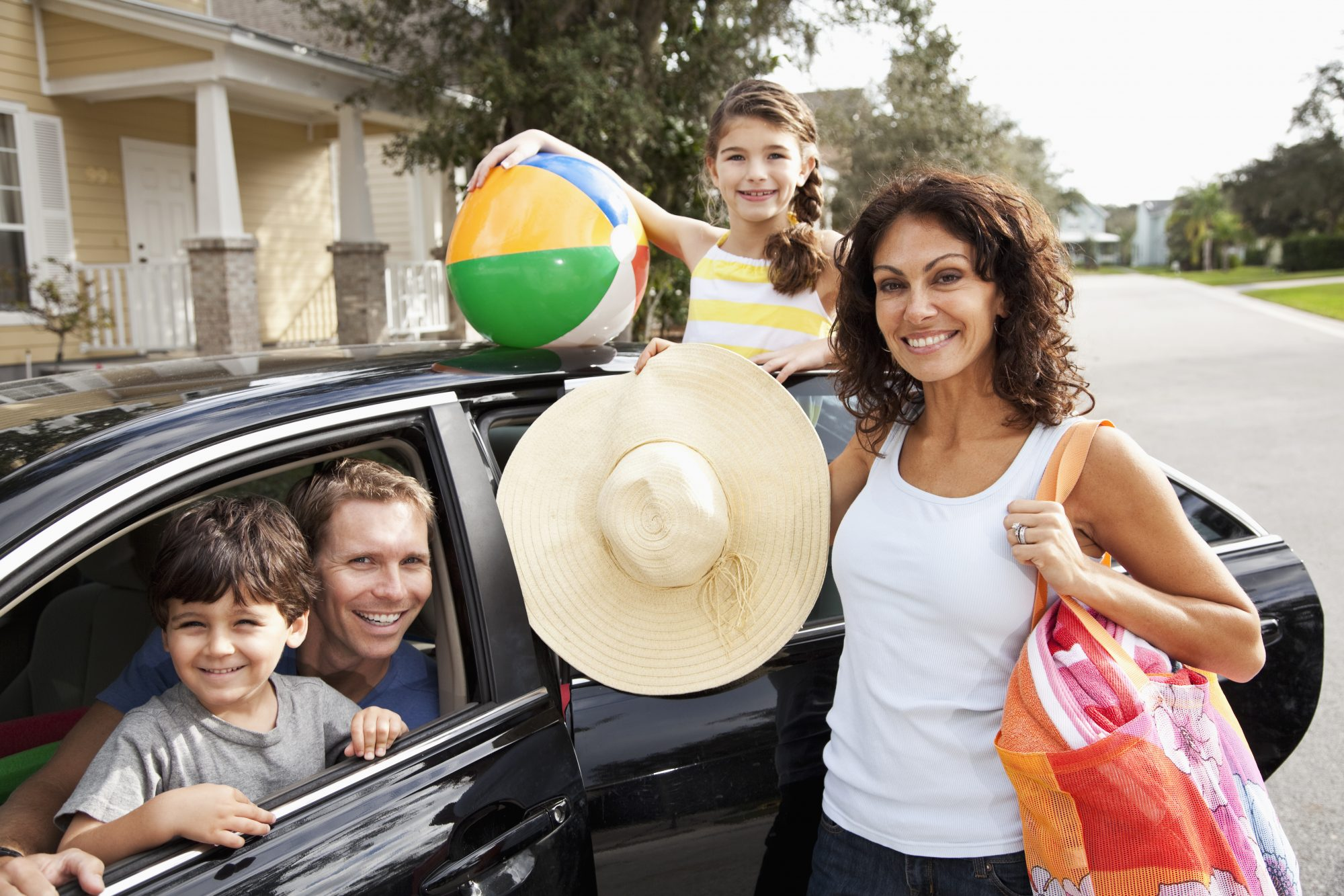 Family in Car Heading on Road Trip