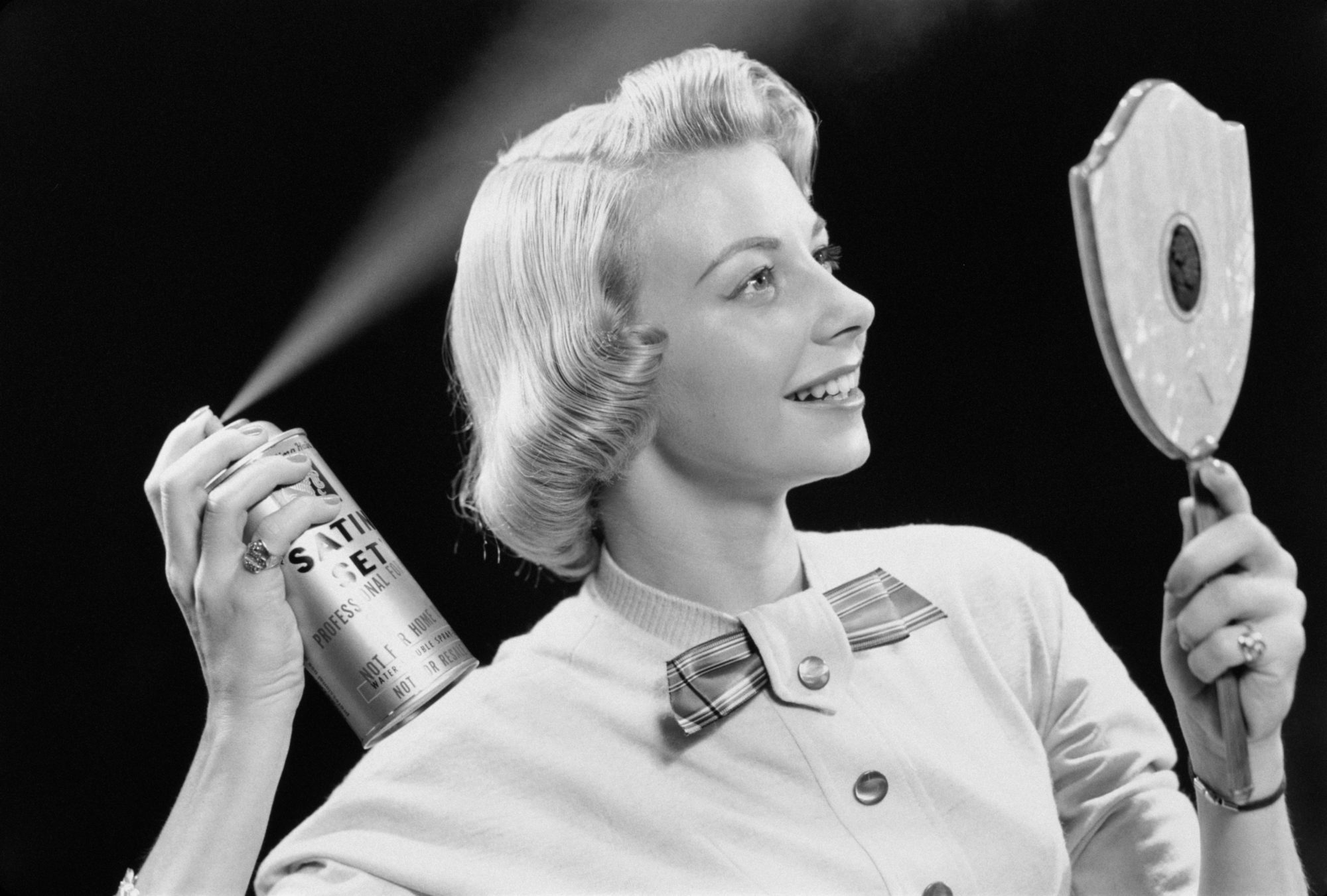 Vintage Woman Spraying Hair with Hairspray