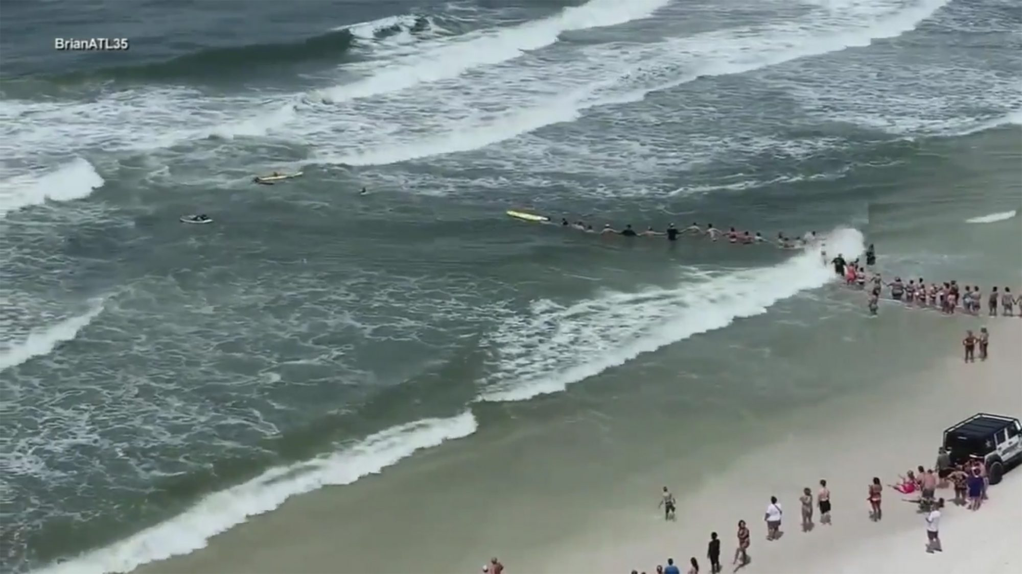 People formed a human chain to rescue 40 people stuck in a rip current in Panama City https://abc7ny.com/weather/video-beachgoers-form-human-chain-to-rescue-swimmer-from-rip-currents/5396035/ Credit: ABC7NY