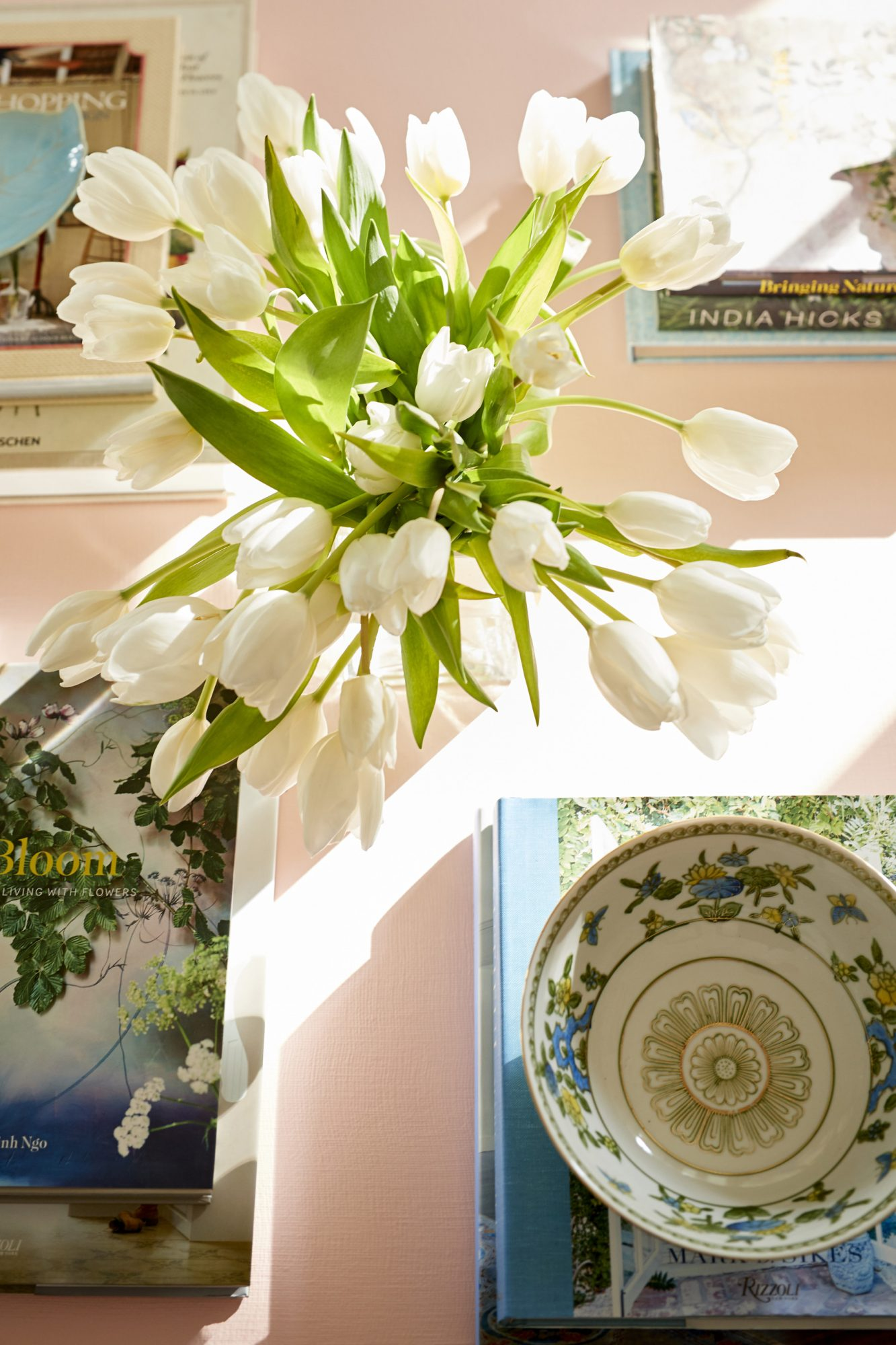 Julia Engel of Gal Meets Glam Charleston Home Flowers on Coffee Table