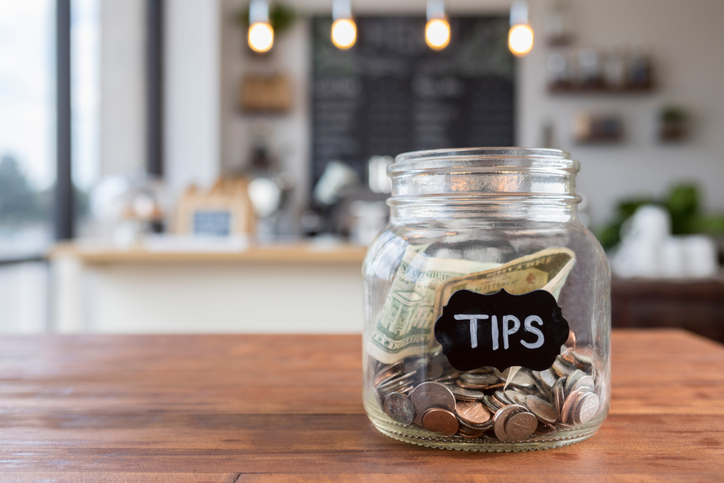 """""Tips"""" jar on coffee shop table"