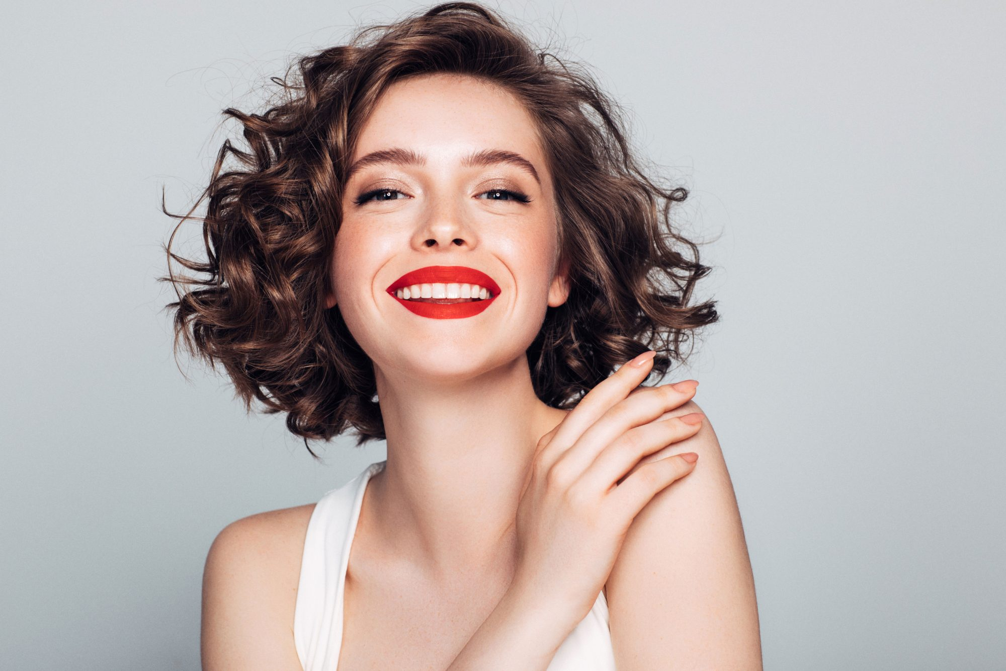 Woman Smiling with Curly Hair