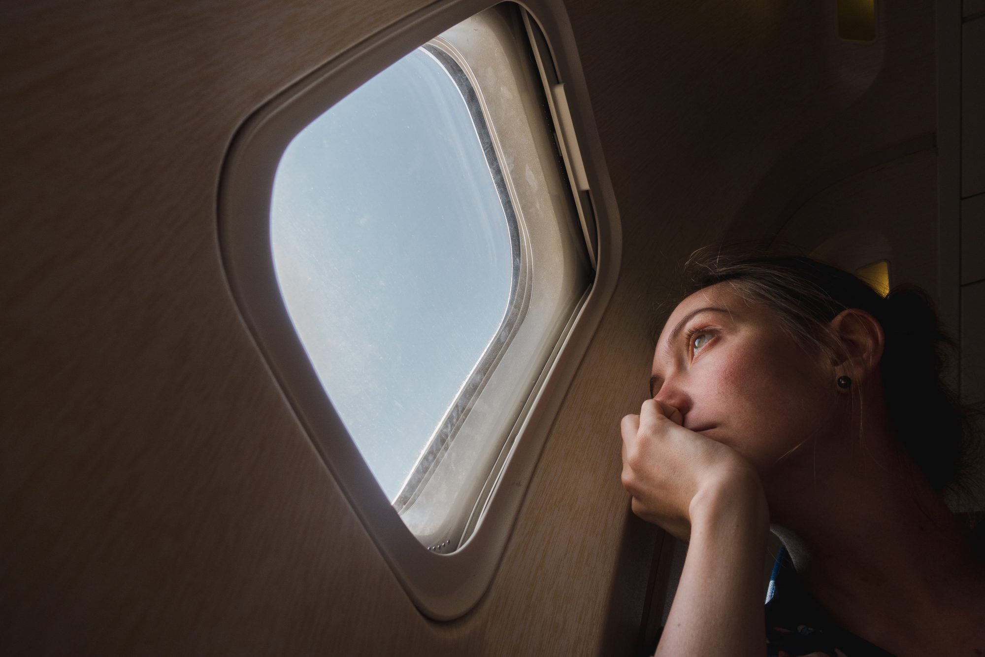 Woman Crying on Airplane