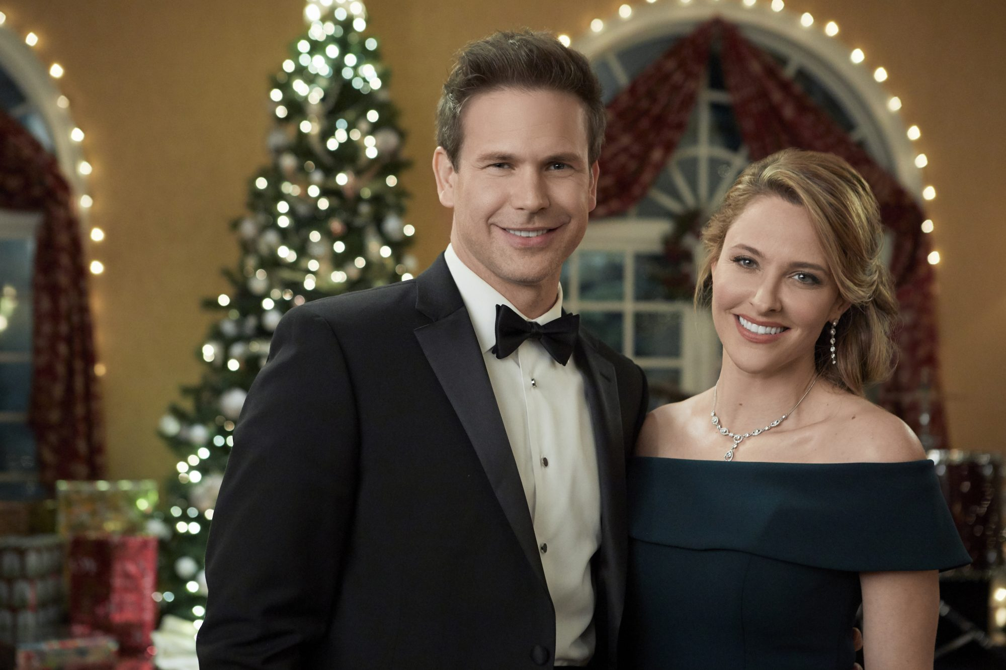 Jill Wagner and Matthew Davis on the set of Hallmark Christmas Movie