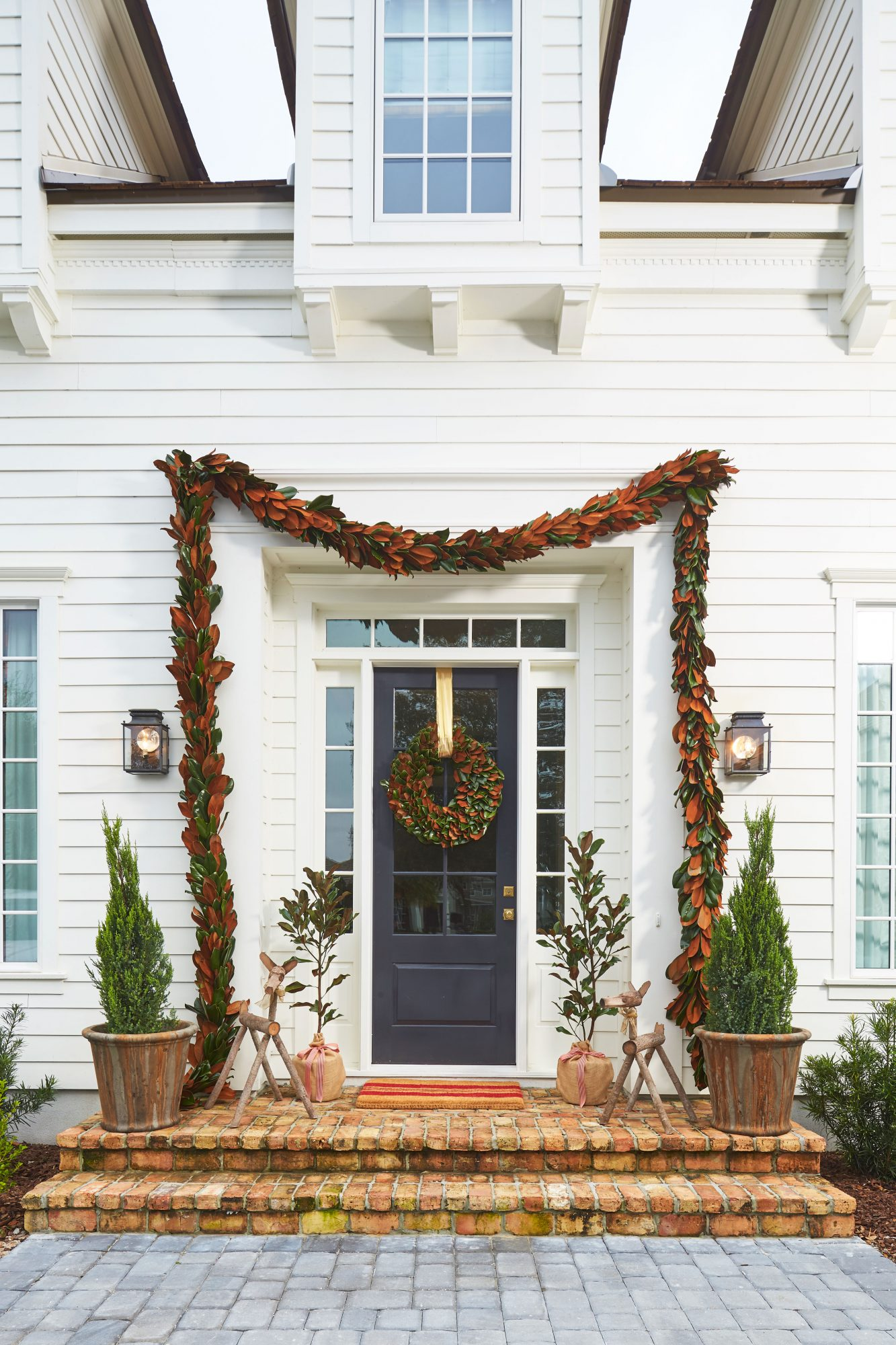Andrew Howard's Home Decorated for Christmas Front Exterior Door with Magnolia Leave Garland and Wreath