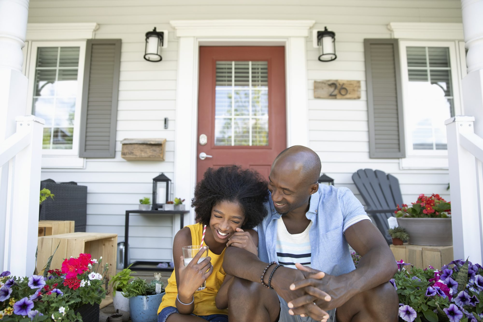 Home Exterior and Father and Daughter on Step