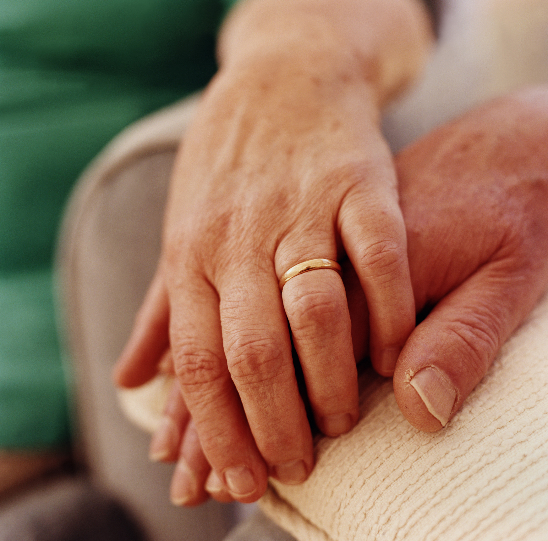 Mature couple's hands, c