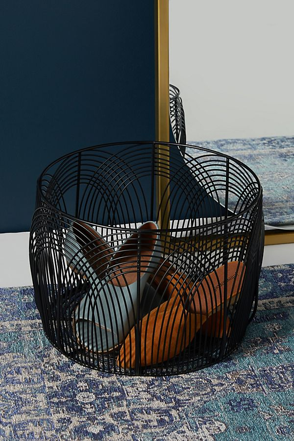 With a wire frame design, this sturdy metal basket can hold countless pairs of shoes.BUY IT: $138; anthropologie.com