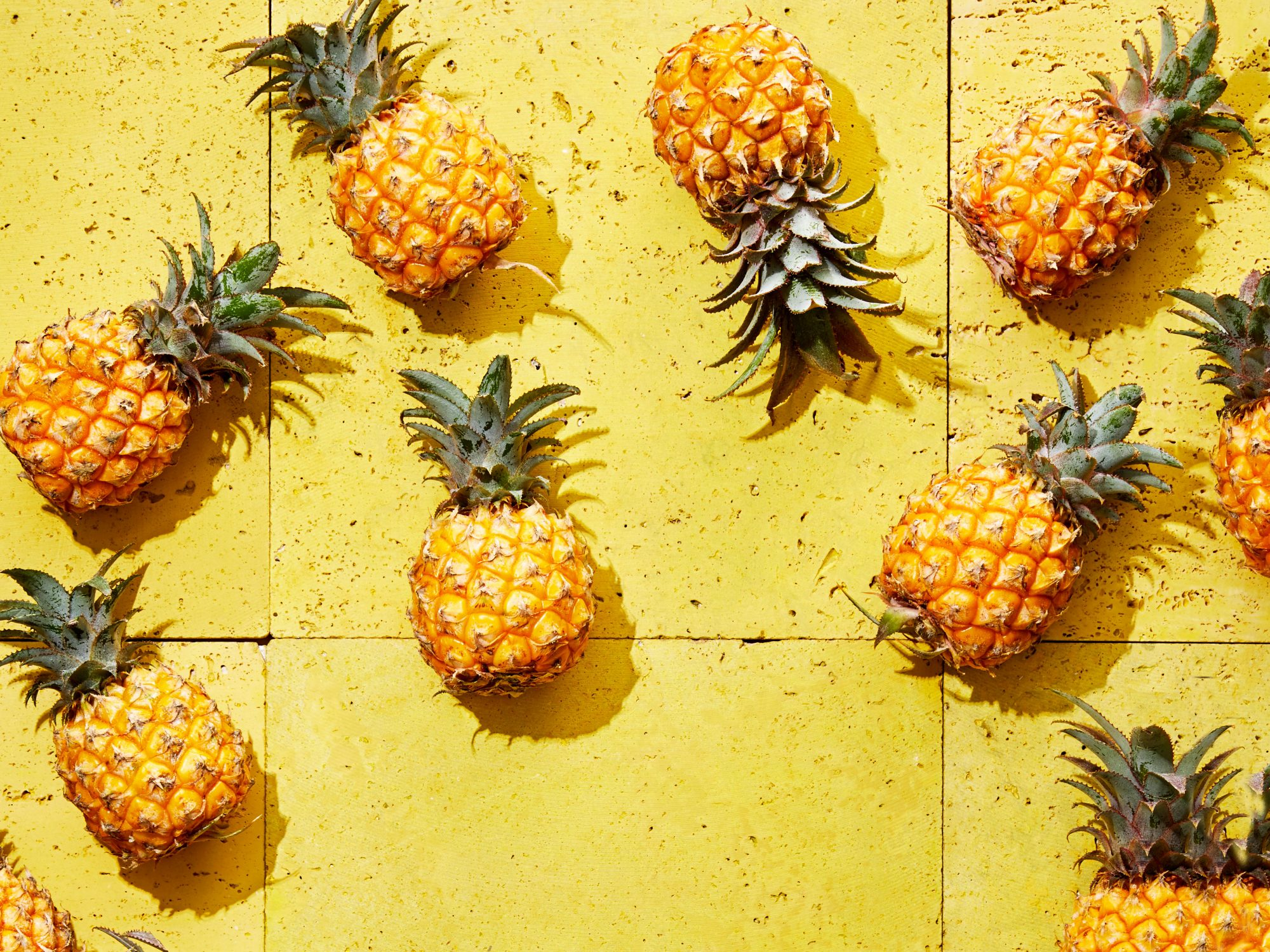 Pineapples on Yellow Background