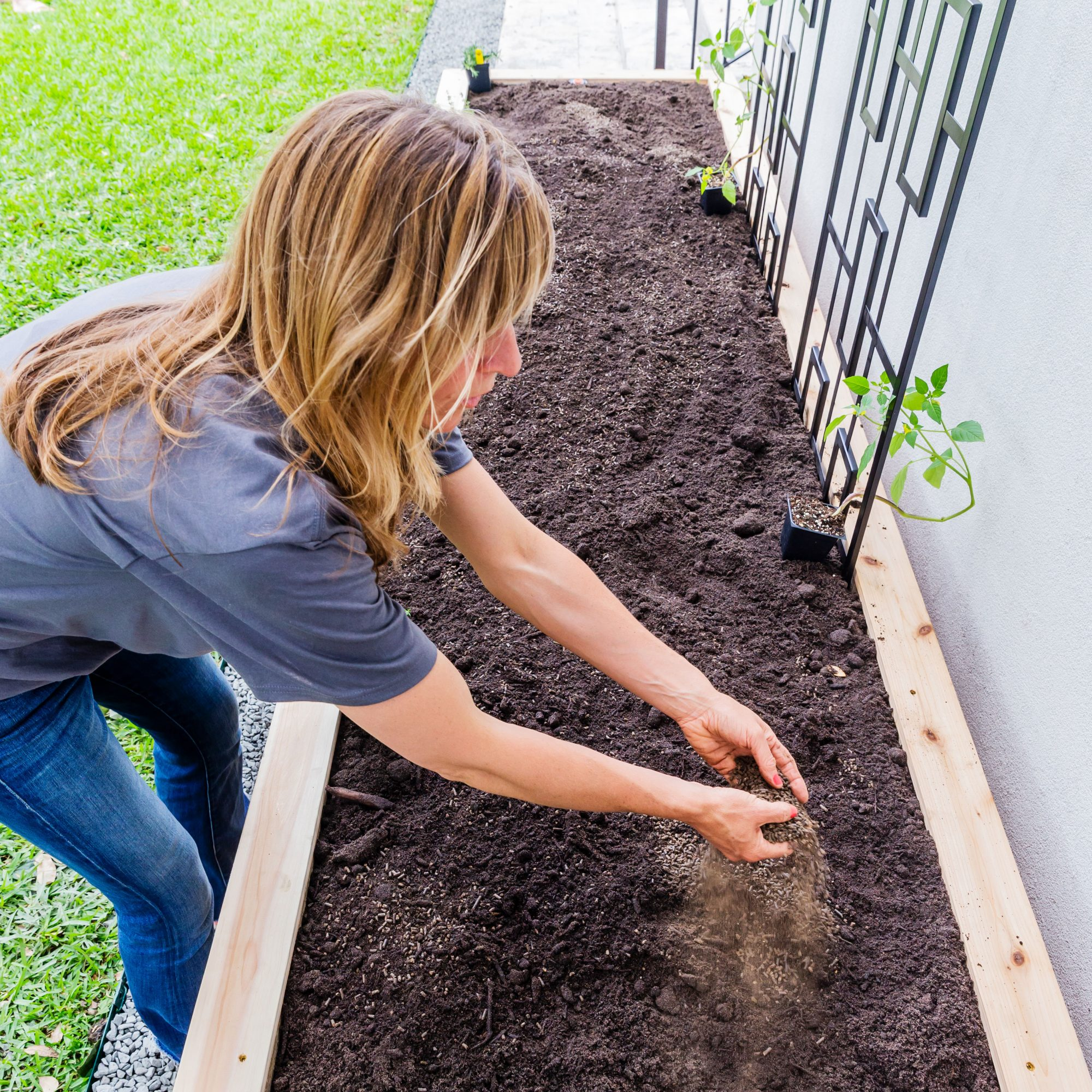 Nicole Burke Fertilizing Raised Garden Bed