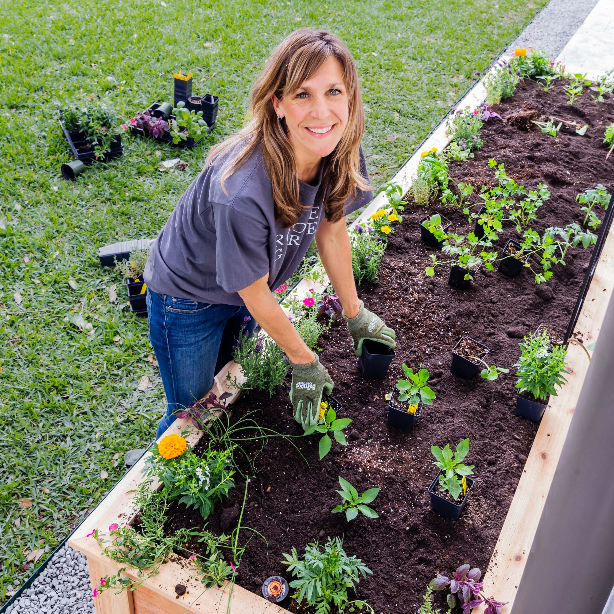 Nicole Burke Planting Kitchen Garden in Raised Bed