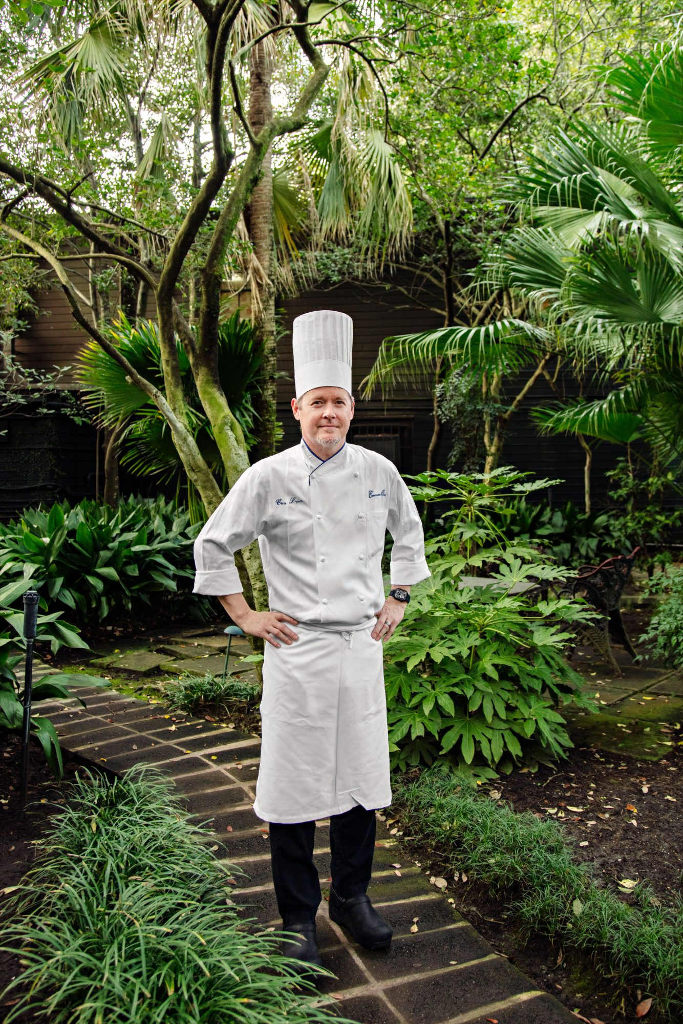 Chef Chris Lynch in the restaurant's lush green courtyard