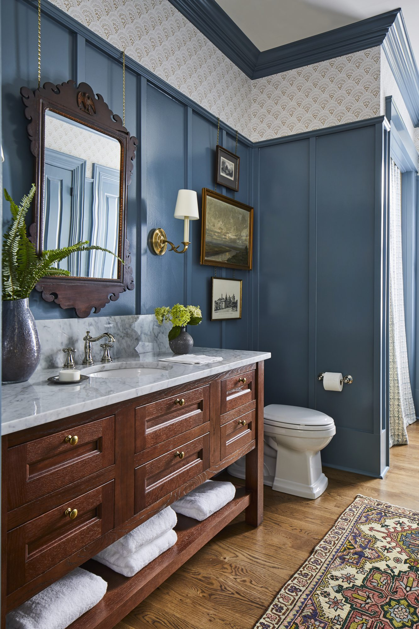 Double Sink Bathroom with Blue Wainscoting
