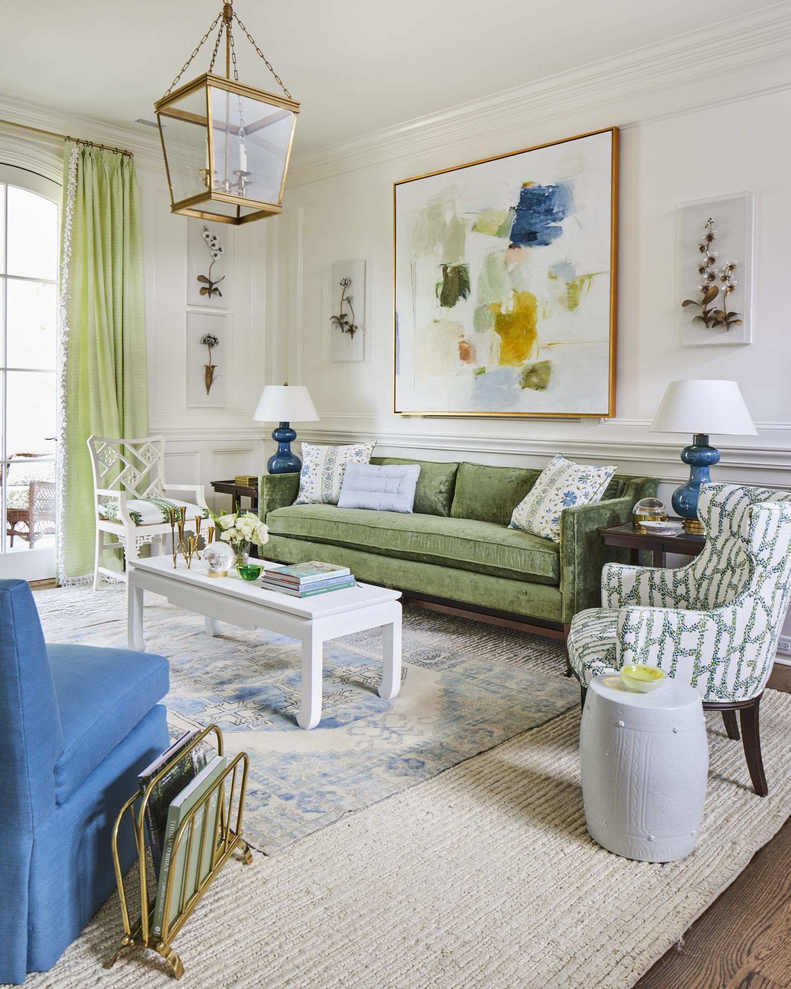 White Loft Space with Green Sofa and Blue Chair
