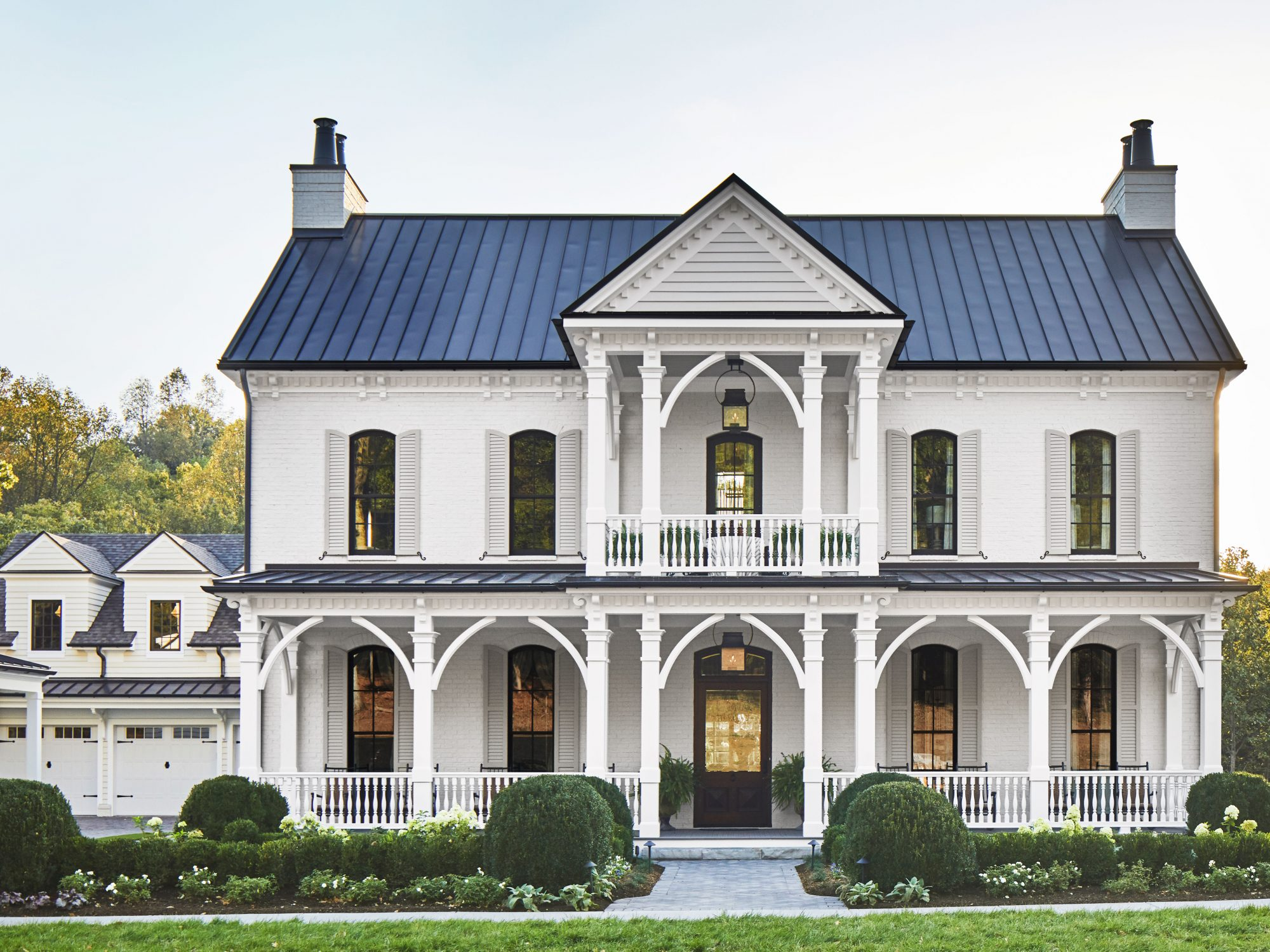 Front Exterior of a White Two Story Farmhouse in Tennessee