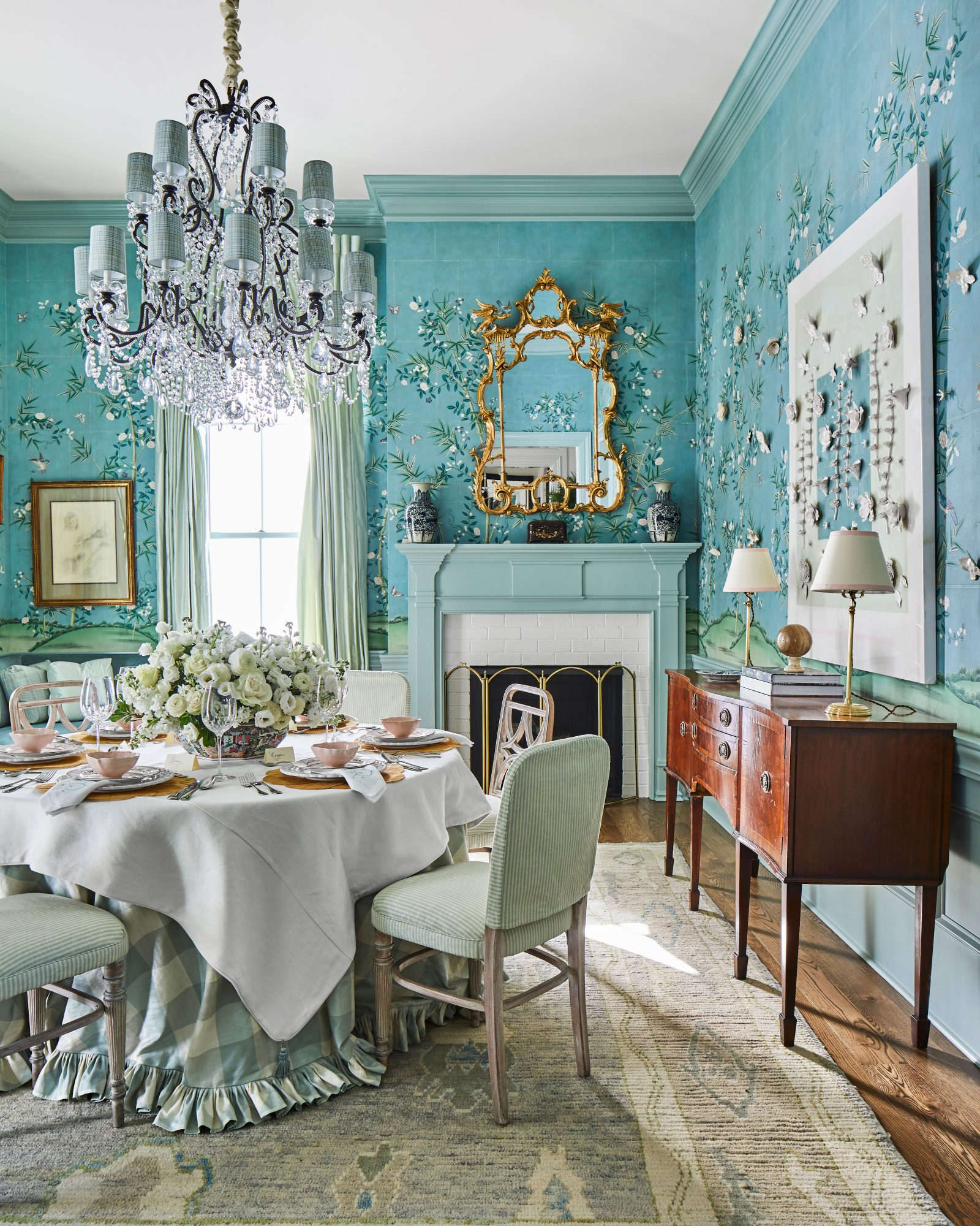 Blue Formal Dining Room with Skirted Table, Crystal Chandelier, and Wallpaper