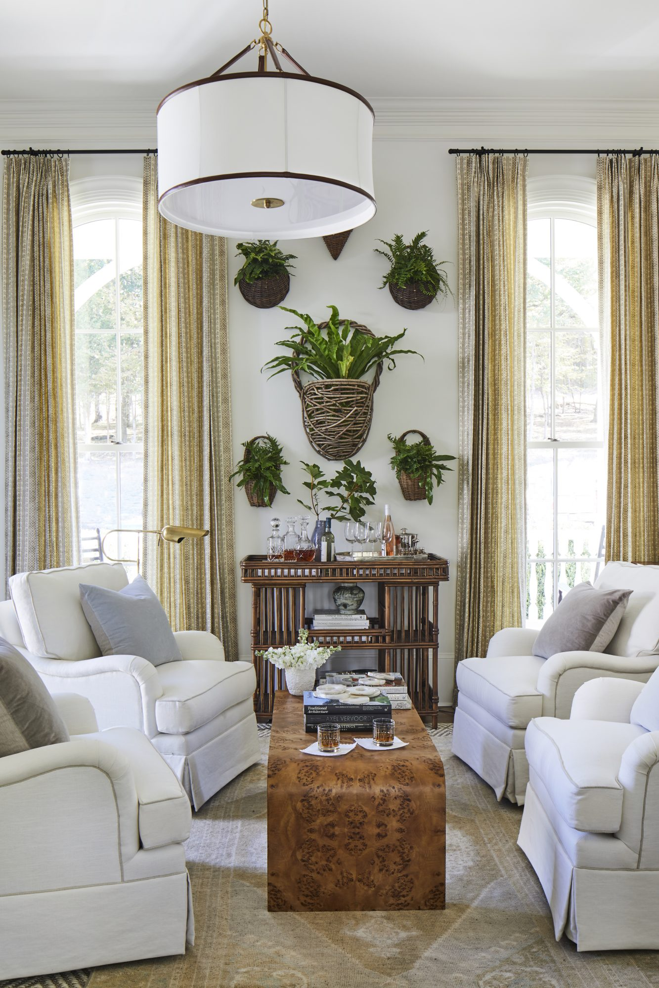 White Room with Hanging Baskets of Indoor Plants