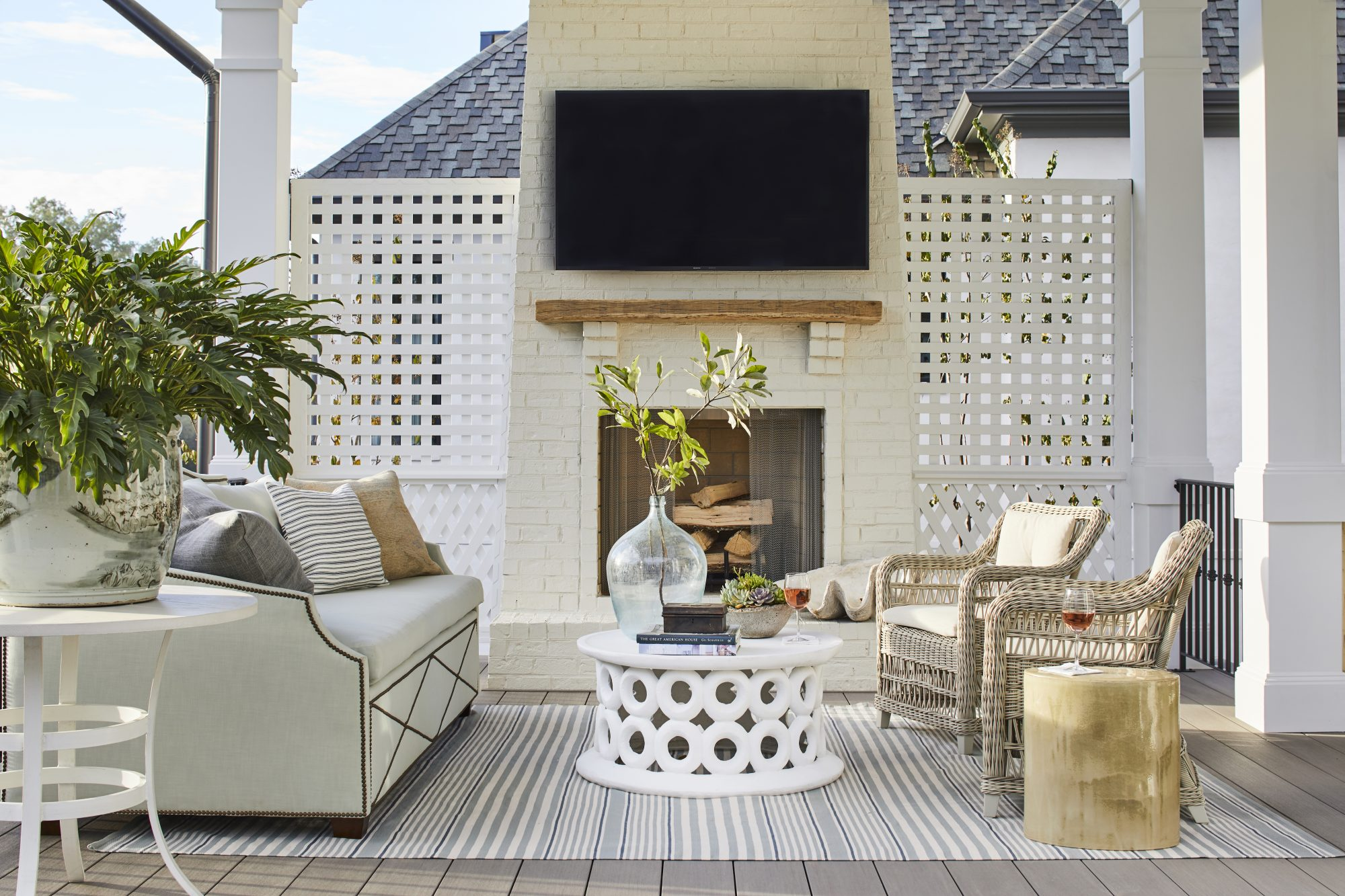 Covered Porch with Fireplace and TV