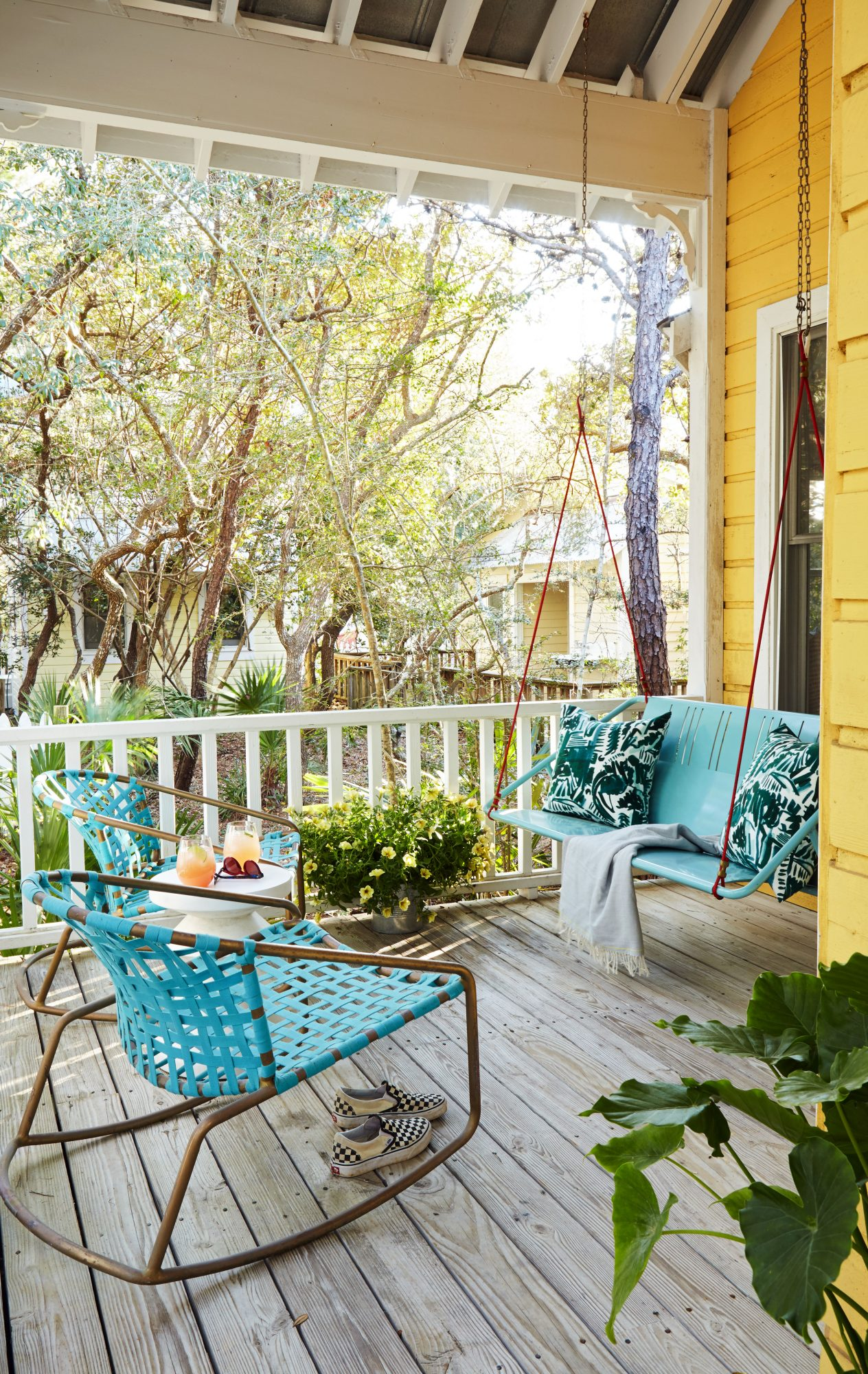 600 Square Foot Cottage Porch with Teal Furniture