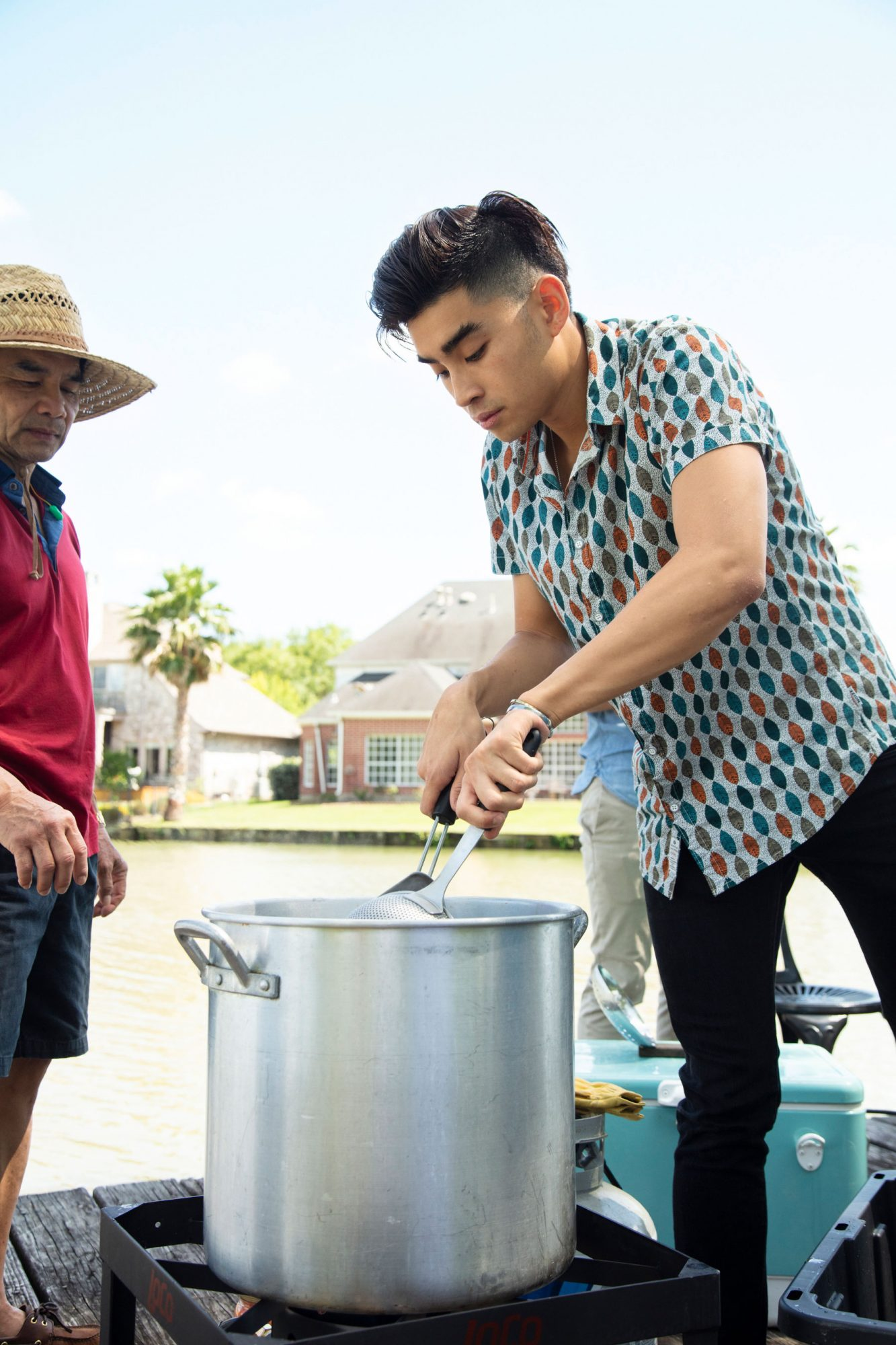 Dan Q. Dao Cooking Crawfish in Stockpot at Family's Viet-Cajun Crawfish Boil