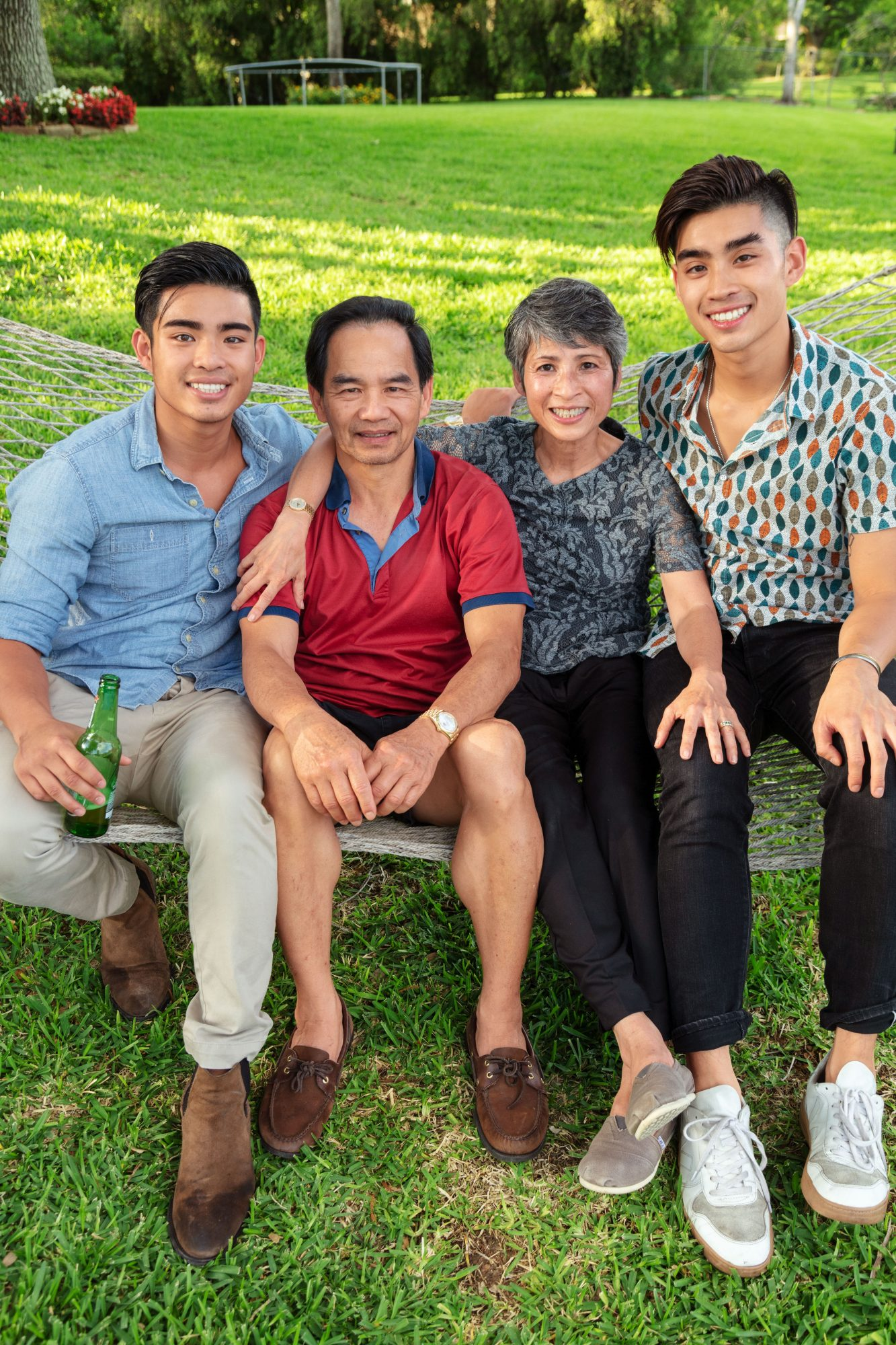 Dan Q. Dao with Brother, Father, and Mother at Family Crawfish Boil in Houston, TX
