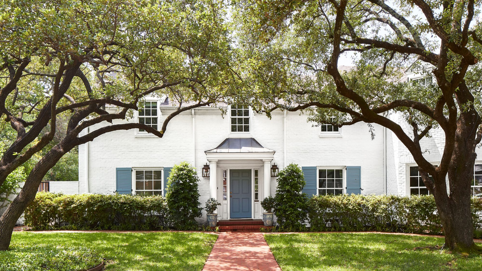 Amy Berry Designed Dallas Home with White Exterior with Blue Shutters