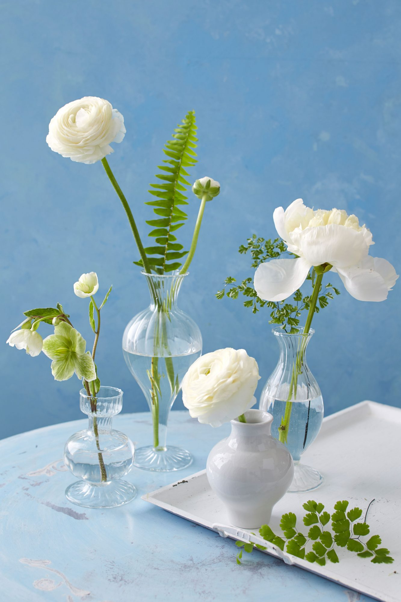 Clear and White Bud Vase Grouping with White Flowers and Greenery