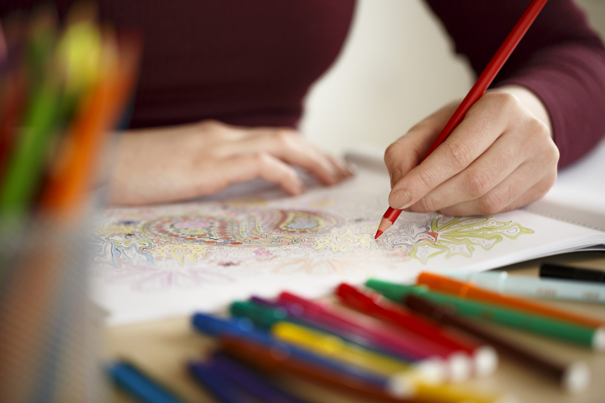 Woman Coloring An Adult Coloring Book