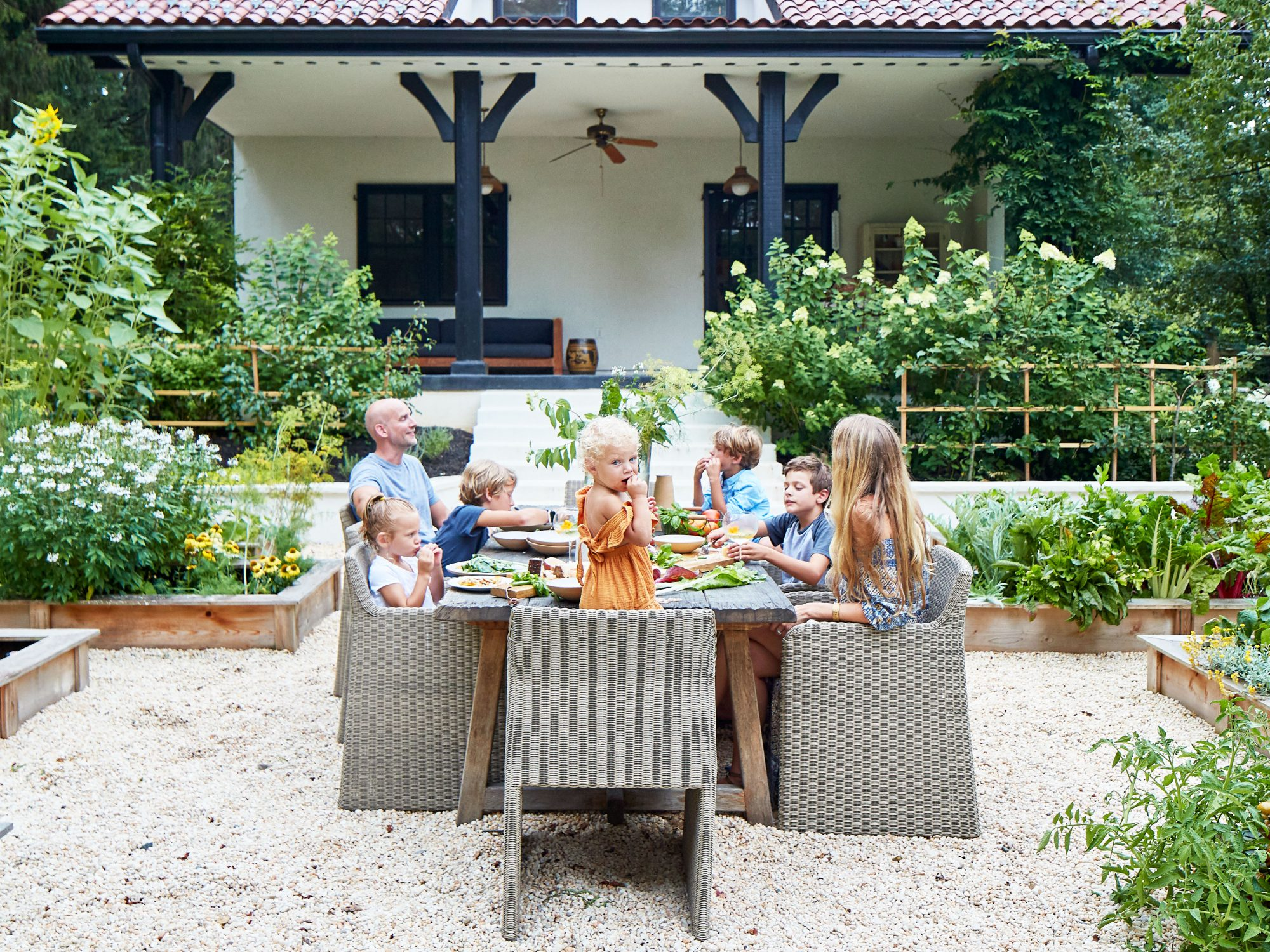 Lauren Liess and Family Eating at Outdoor Dining Table in Their Garden