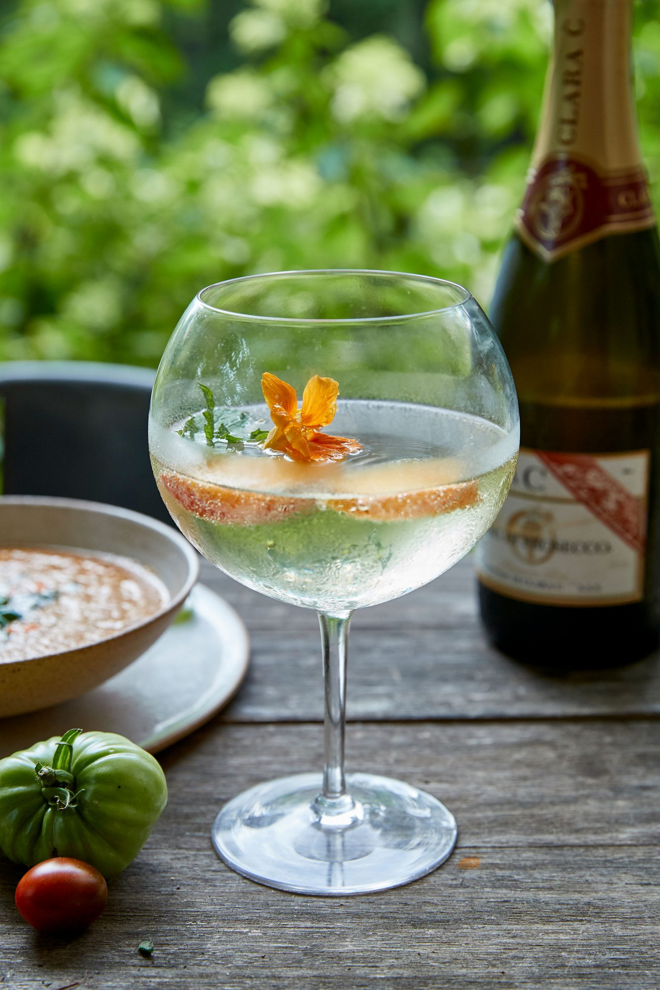Lauren Liess Cocktail: Prosecco SpritzerGarnished with Nasturtium Petals and Peach Slices