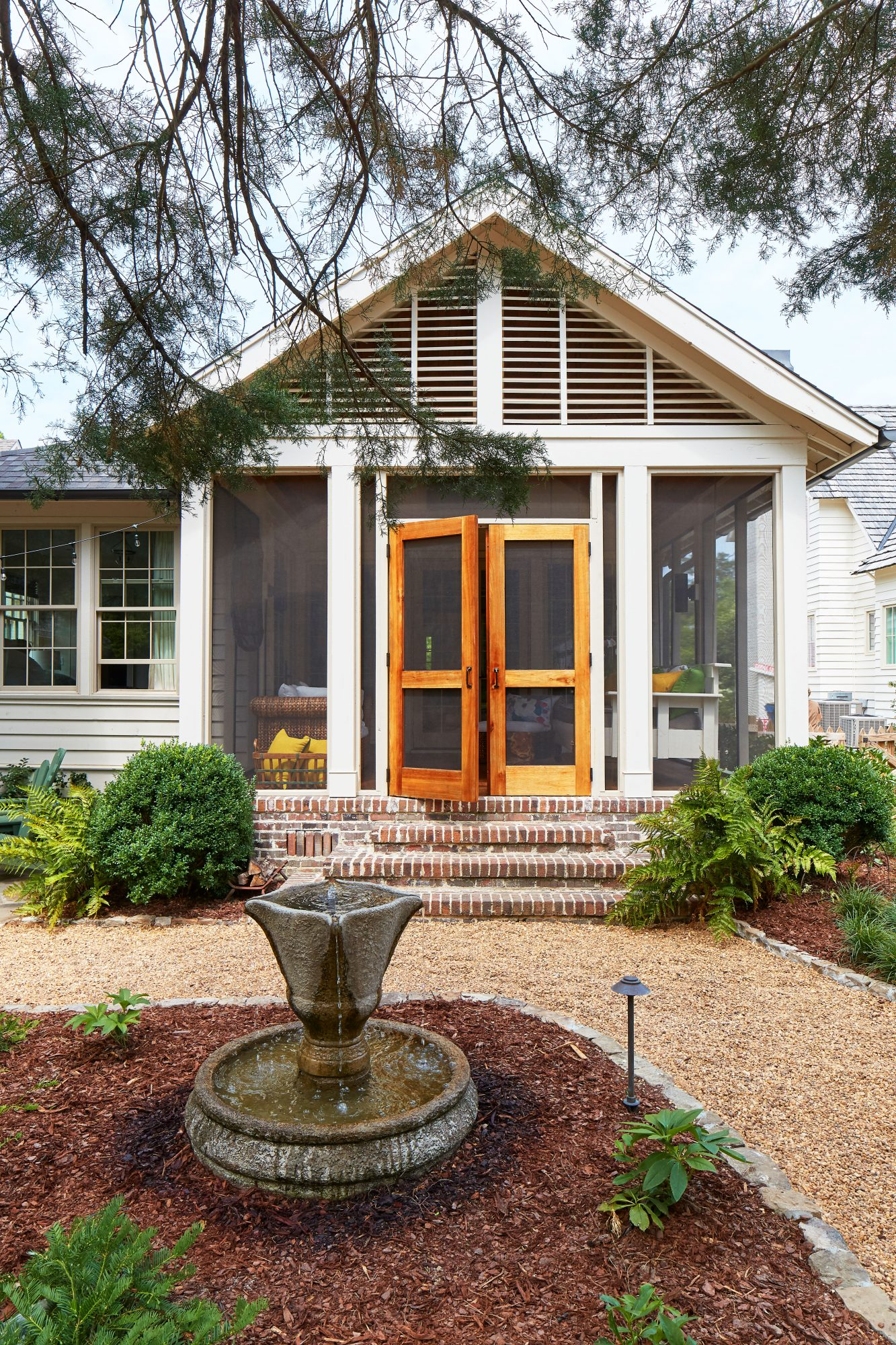 Natural Backyard Design Screened Porch with Double Doors
