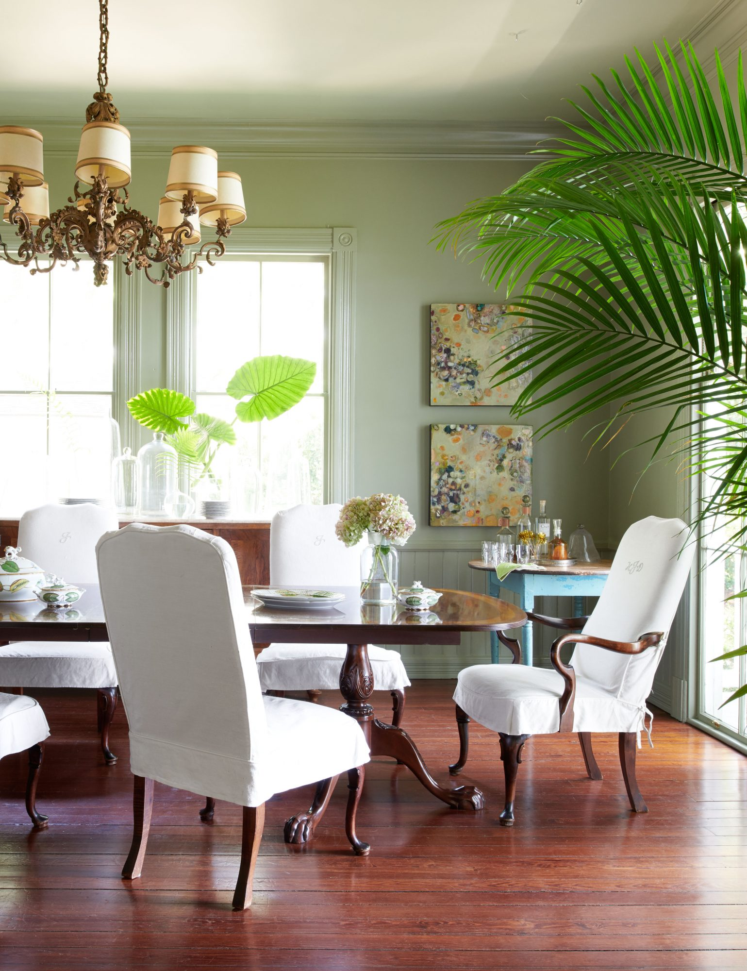 Sage Green Dining Room with White Chairs