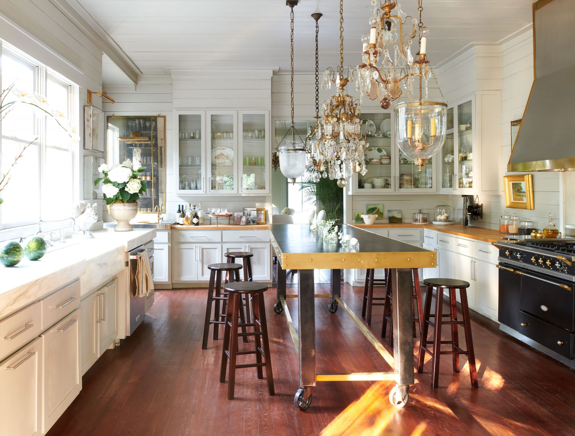 Neutral Kitchen with Butcher Block Island and Mixed Light Fixtures