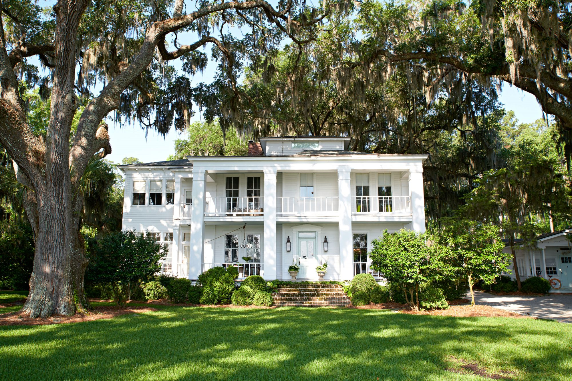 Two Story, White Federal-Style House Under Live Oak Trees