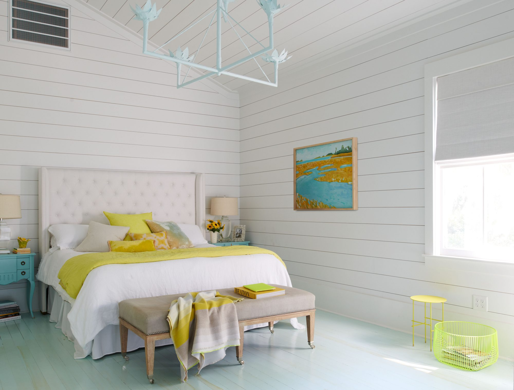 White Bedroom with Neon Pops of Yellow and Teal on Bed