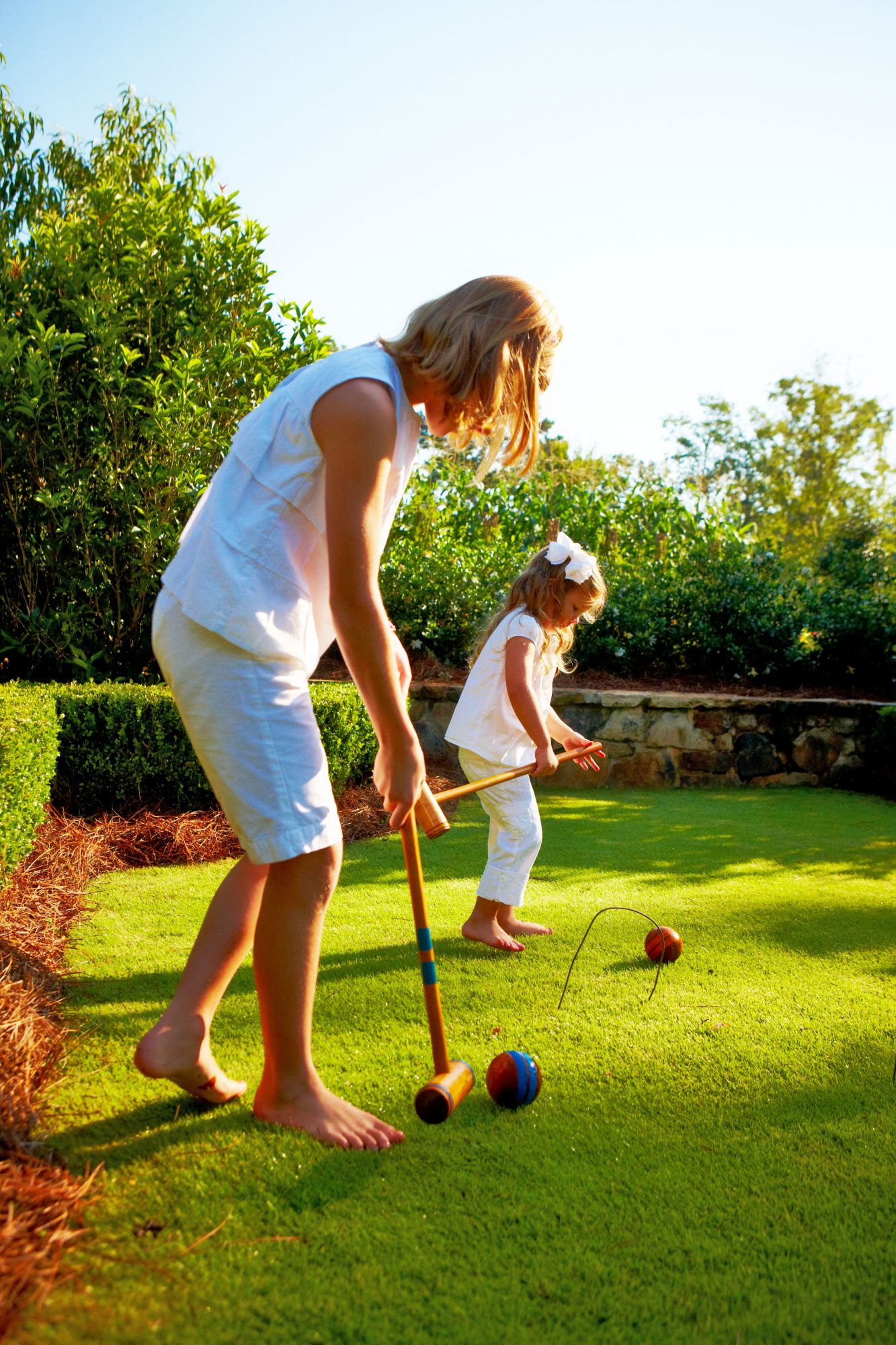 Two Young Girls Playing Croquet