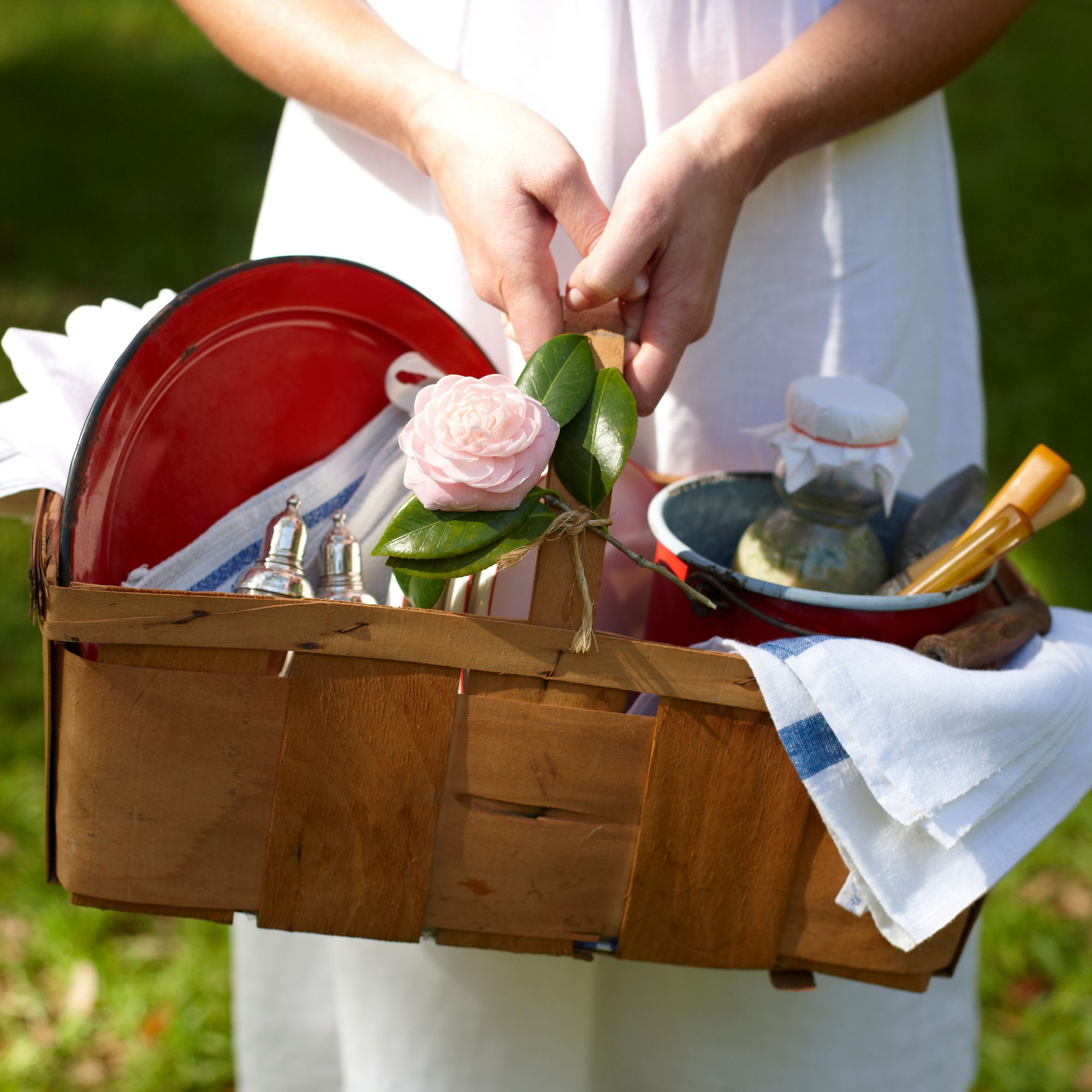 Woman Holding Packed Picnic Basket