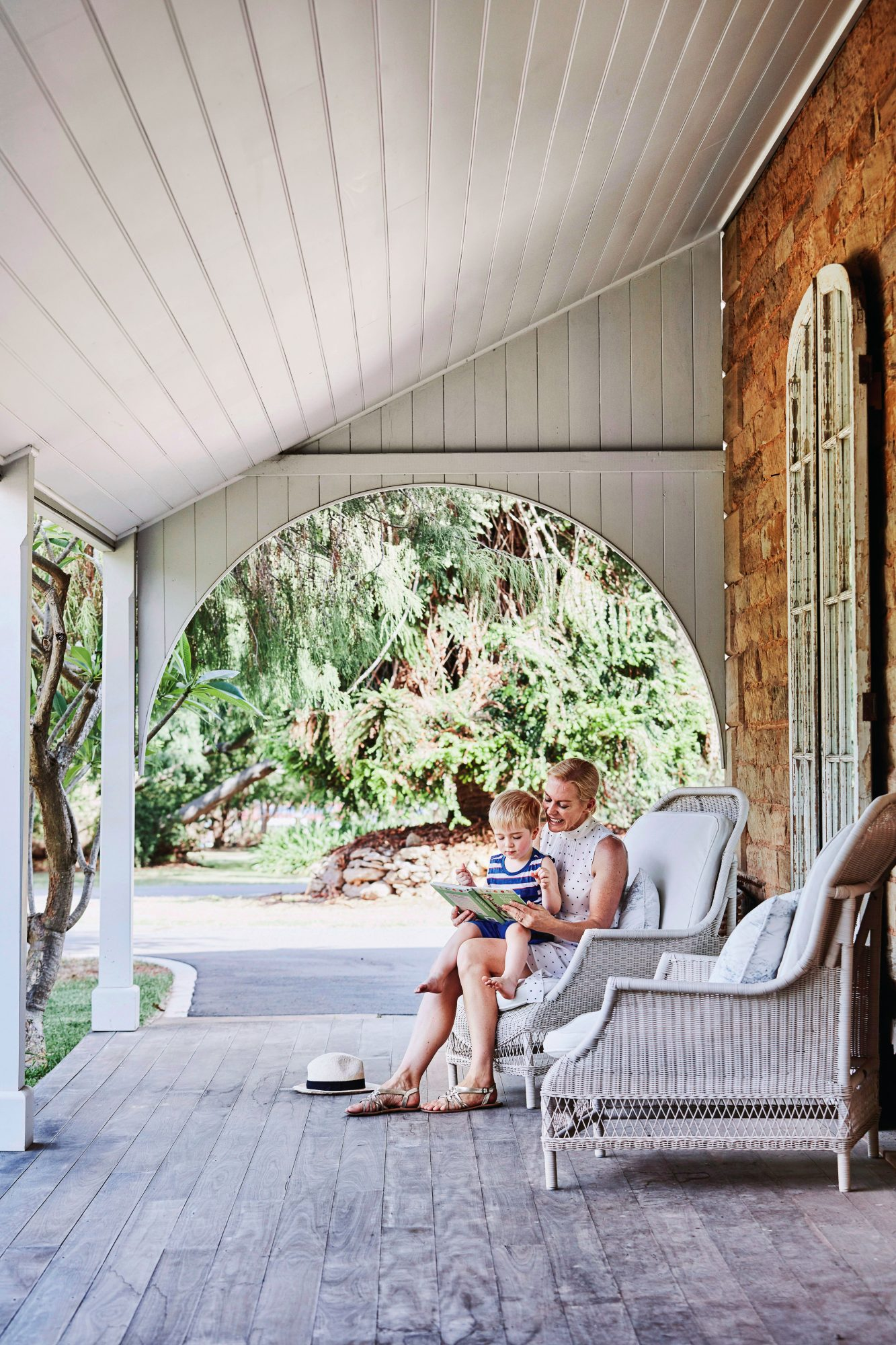 Mom Reading Book to Son on Porch