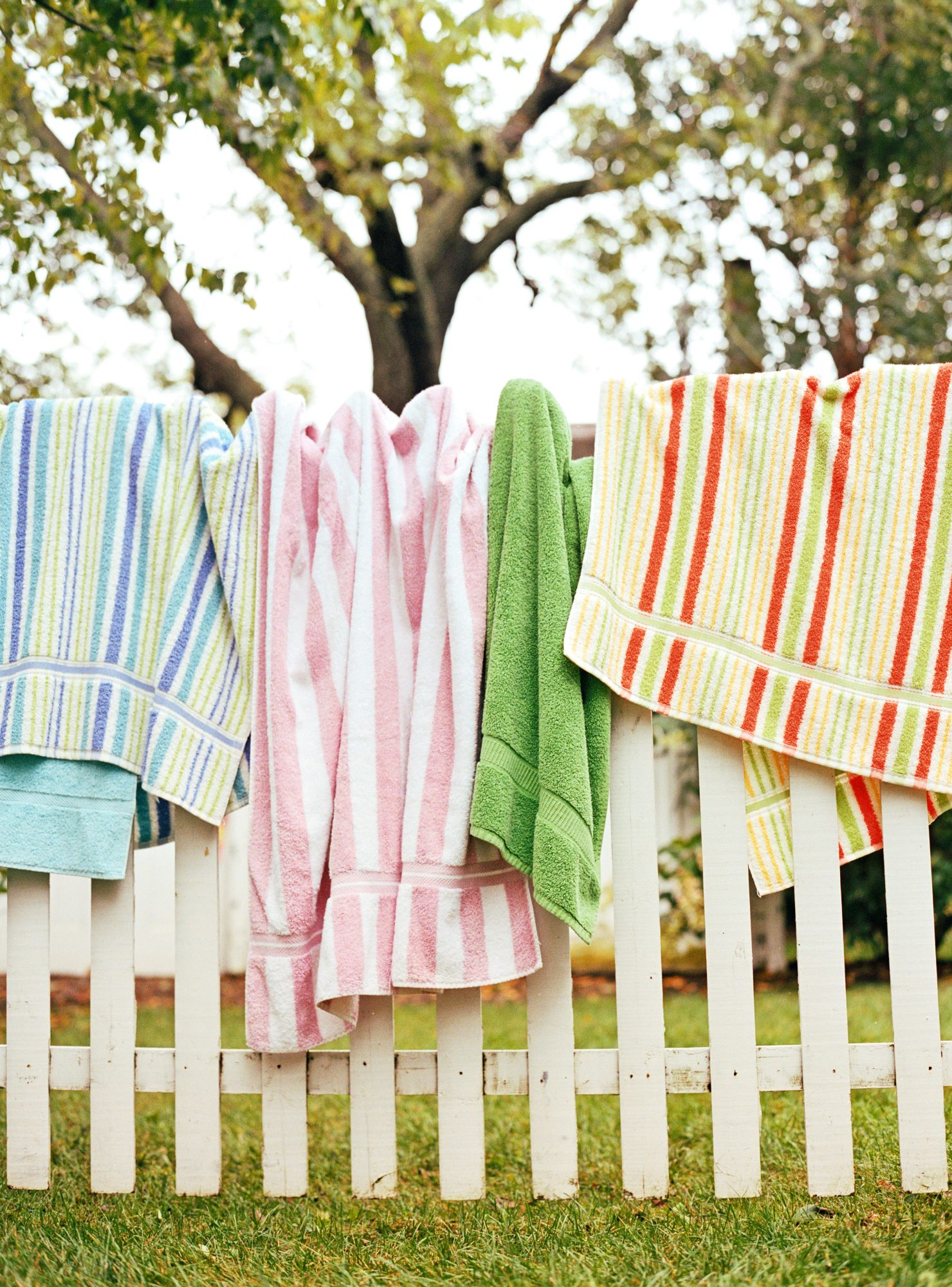 Beach Towels Hanging on Fence
