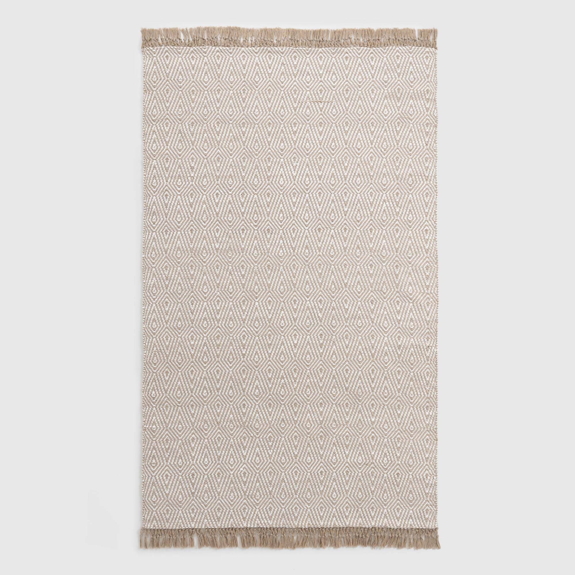 A diamond pattern and fringed edges dress up this neutral handwoven rug.BUY IT: from $150; worldmarket.com