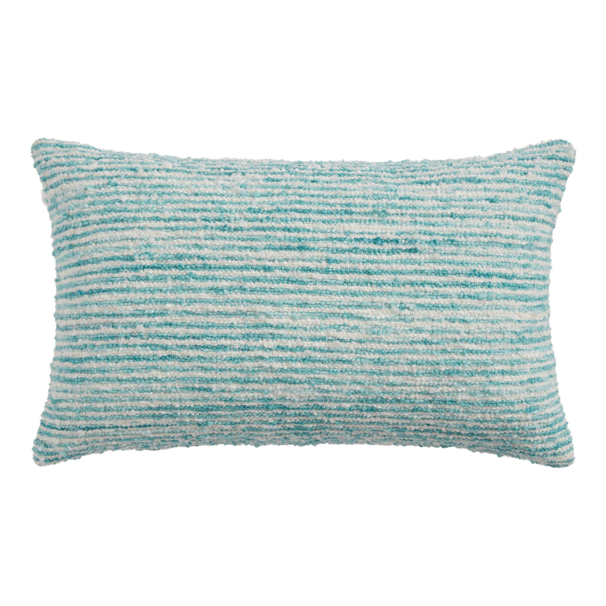 Style the sofa with a plush lumbar pillow in a beachy blue hue.                                       BUY IT: $30; worldmarket.com