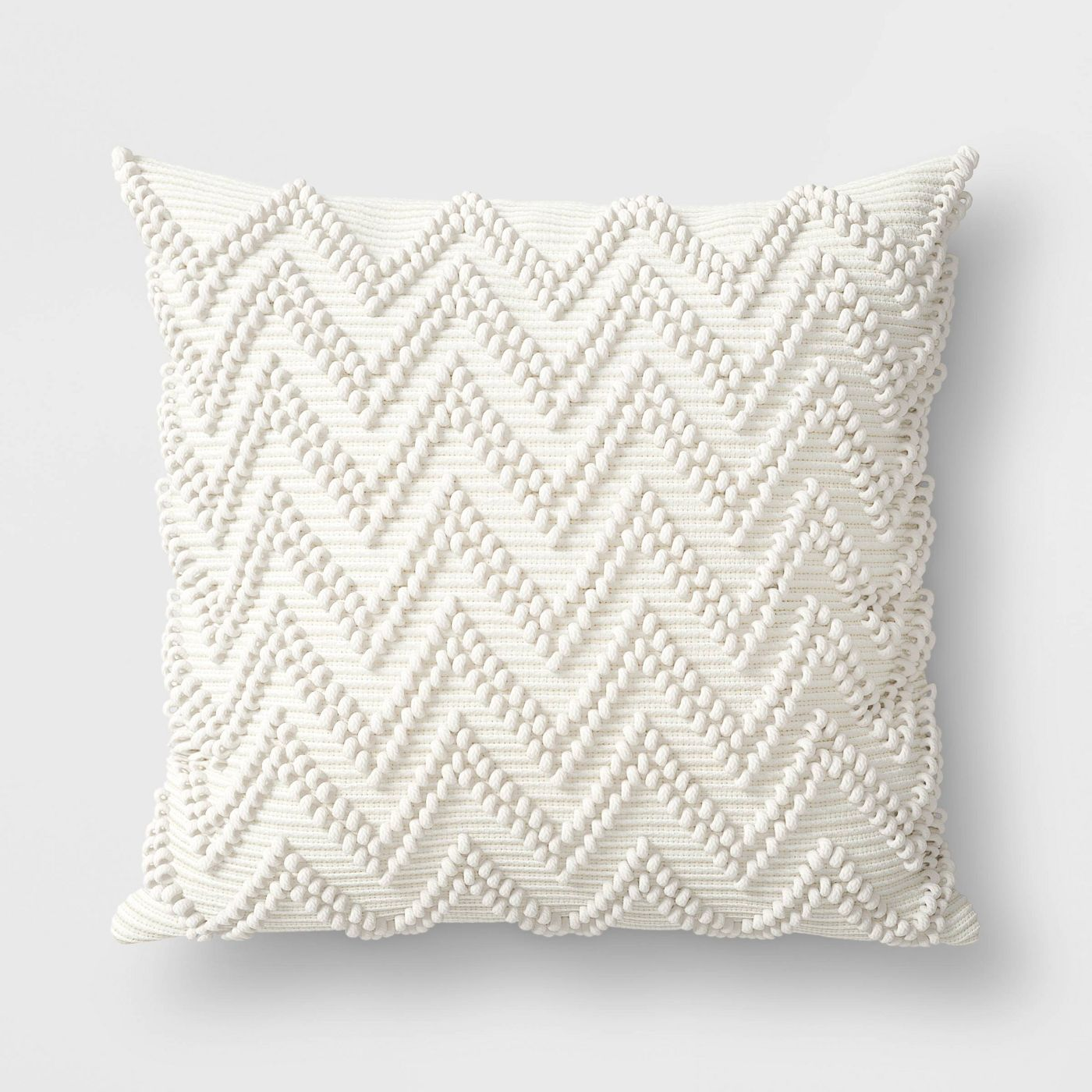 A raised zigzag pattern makes this square pillow anything but boring.                                       BUY IT: $20; target.com