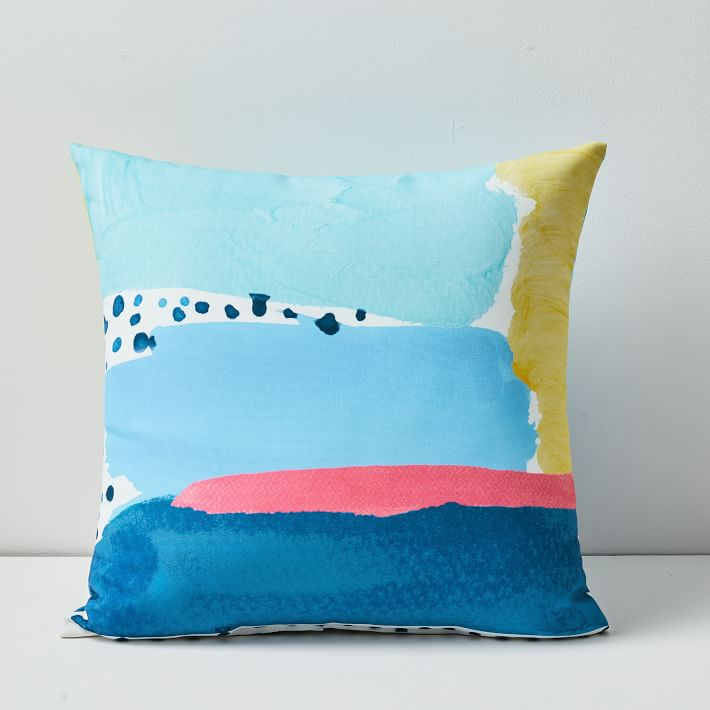 This colorful abstract pillow is as pretty as it is practical.                                       BUY IT: $39; westelm.com